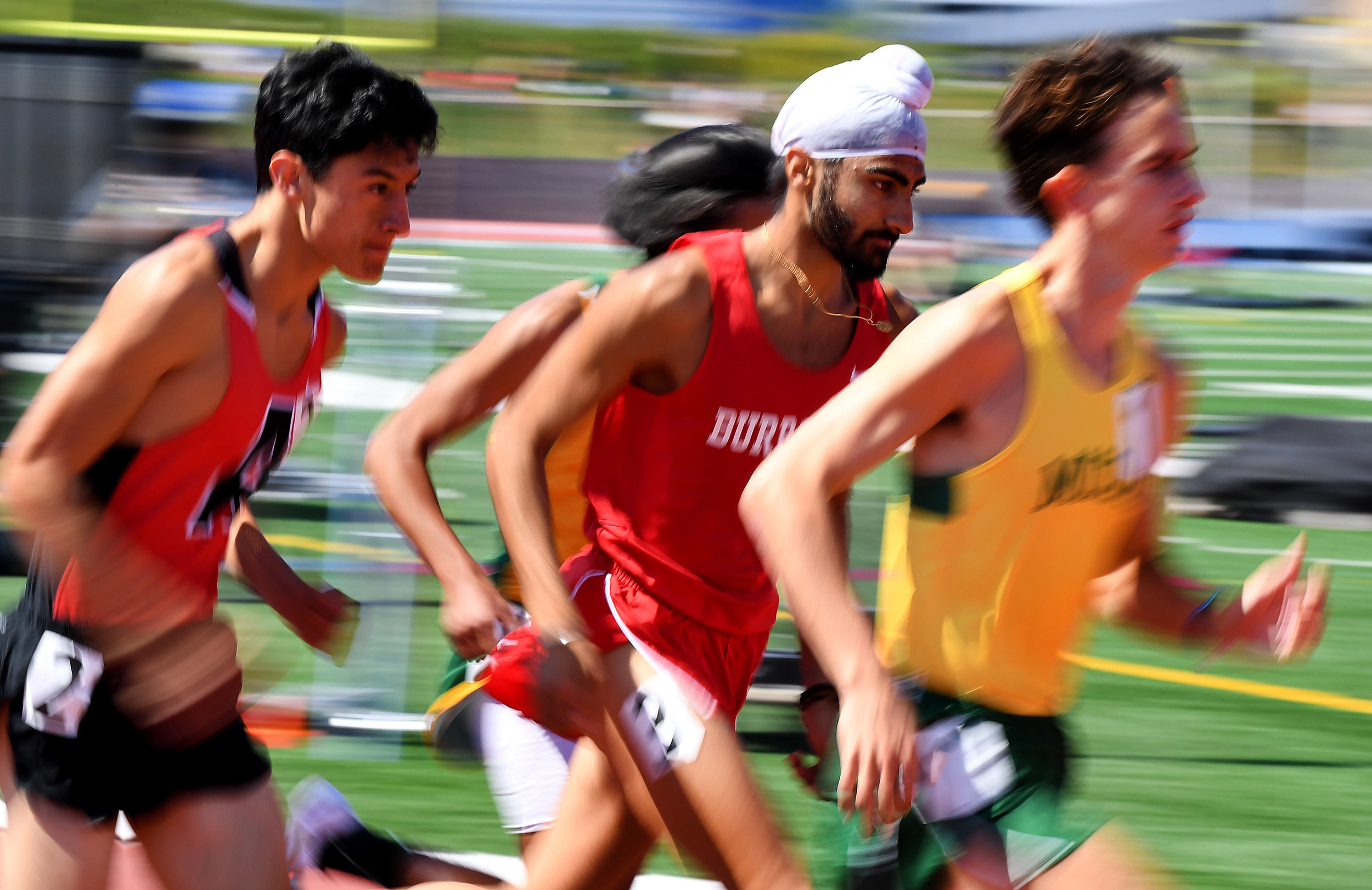 Burroughs' Jagdeep Chahal, center, finished third in the 3200 meter run as Mira Costa's Xavier Court  wins during the CIF-SS Track and Field Masters meet at El Camino College in Torrance, Calif., on Saturday, May 26, 2018.