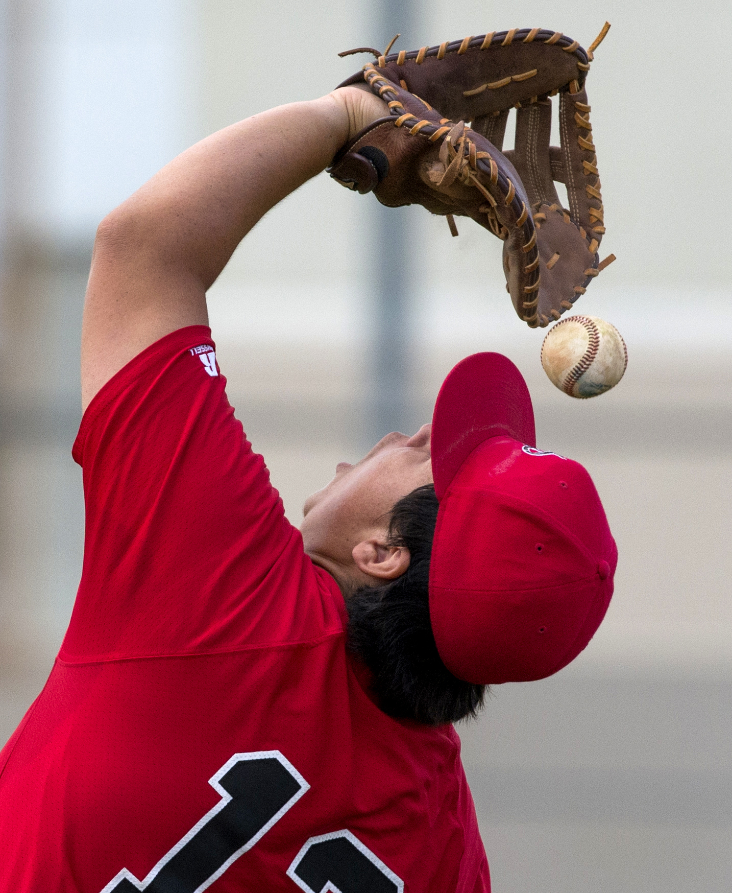 Harbor Teacher Prep's Jeff Slater(13) can�t hang on to the ball after a pop-up against Rancho Dominguez as the teams battle for the L.A. City Section Div. III baseball semifinal in Long Beach, Tuesday, May 29, 2018.