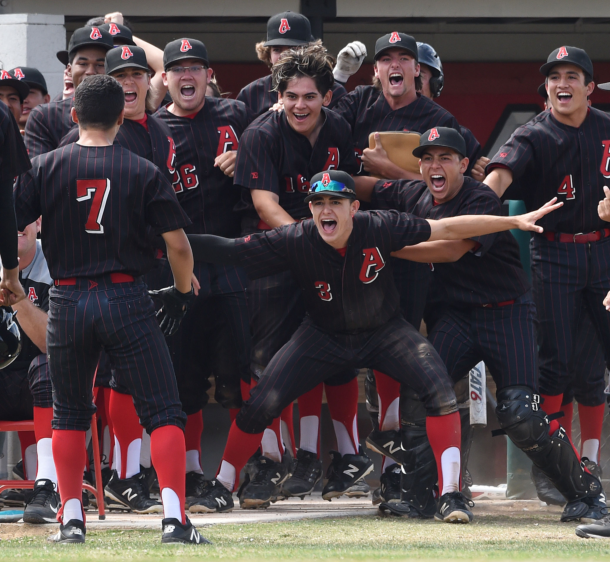 Ayala players celebrate as they prepare to greet teammate Daniel Mendez (7) after hitting a 3-run home run against Yucaipa during the fourth inning Tuesday. Yucaipa eliminates Ayala 7-3 in a prep baseball CIF Southern Section Division 2 semifinal playoff game Tuesday May 29, 2018 at Ayala High School in Chino Hills, Calif.