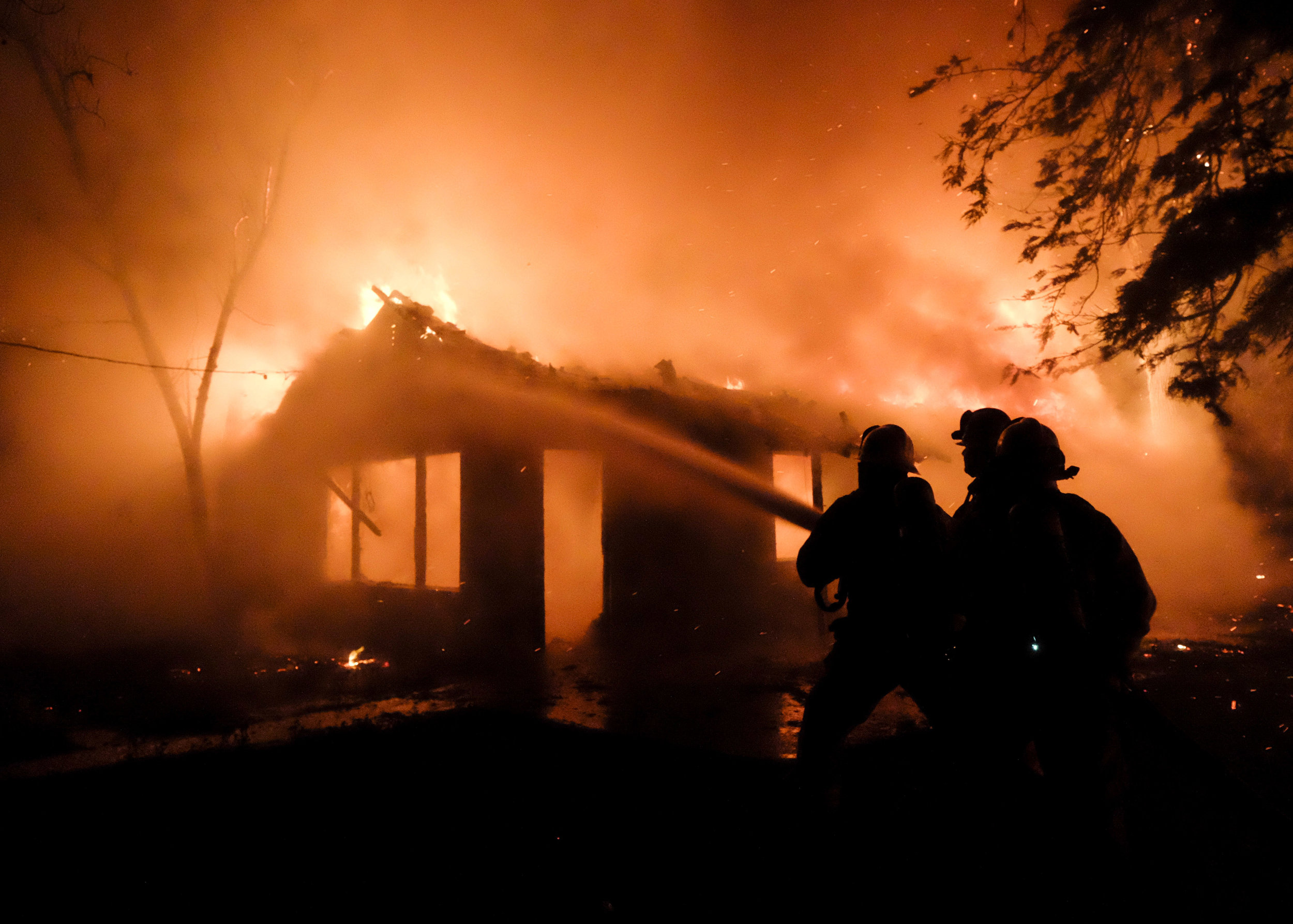 Firefighters battle a fire that destroyed a house Wednesday night, May 2, 2018, in Rosemead, California.