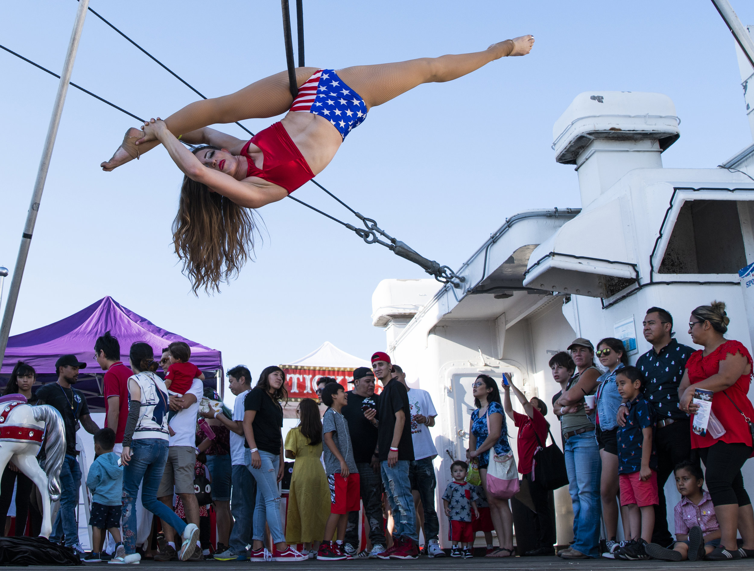 A acrobatics perform on a hoop as the Queen Mary host an All-American 4th of July with live entertainment, family games, arts & crafts and special historic tours along with a signature fireworks spectacular on the legendary ship in Long Beach July 4, 2018.
