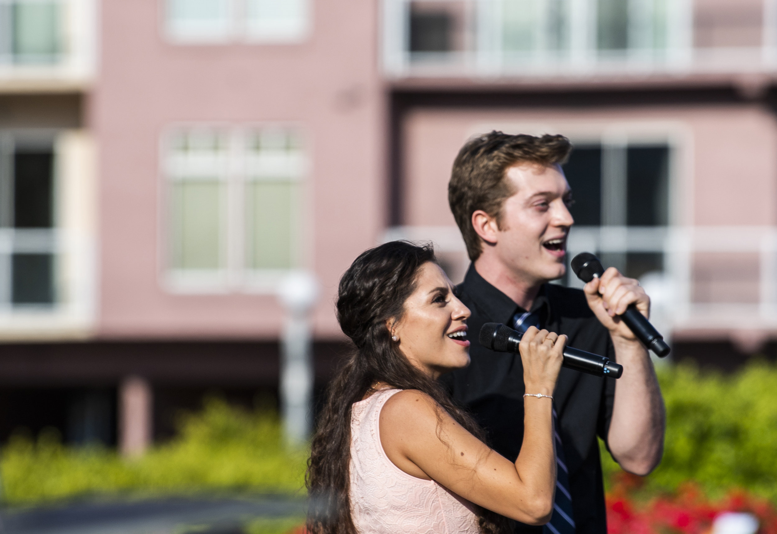 Amy Olivo and Adam Strand performers from Musical Theater West sing before the Long Beach mayor, other city leaders are sworn into new terms at the inauguration ceremony in Long Beach July 17, 2018.