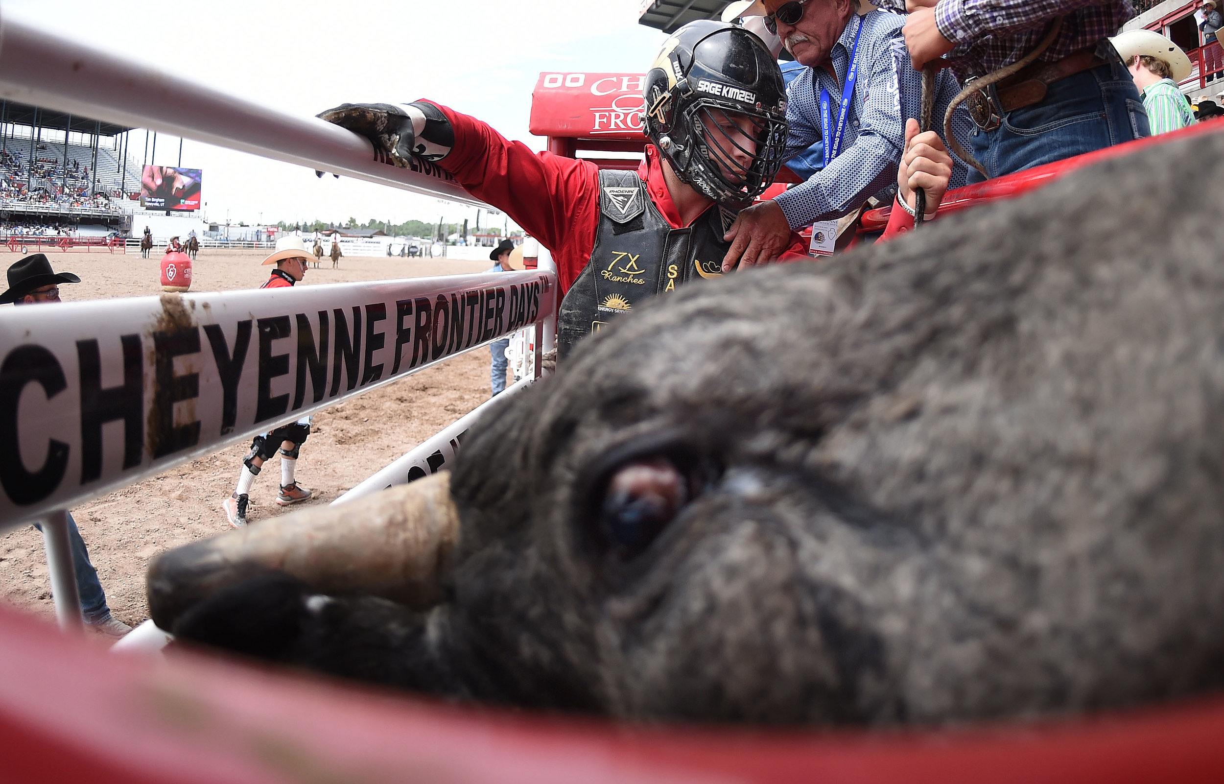 Champion bull rider Sage Kimzey, from Strong City, Oklahoma, prepares to ride Blue Stone during the 6th performance at the 122nd Cheyenne Frontier Days Rodeo at Frontier Park in Cheyenne, Wyoming Wednesday, July 25, 2018.