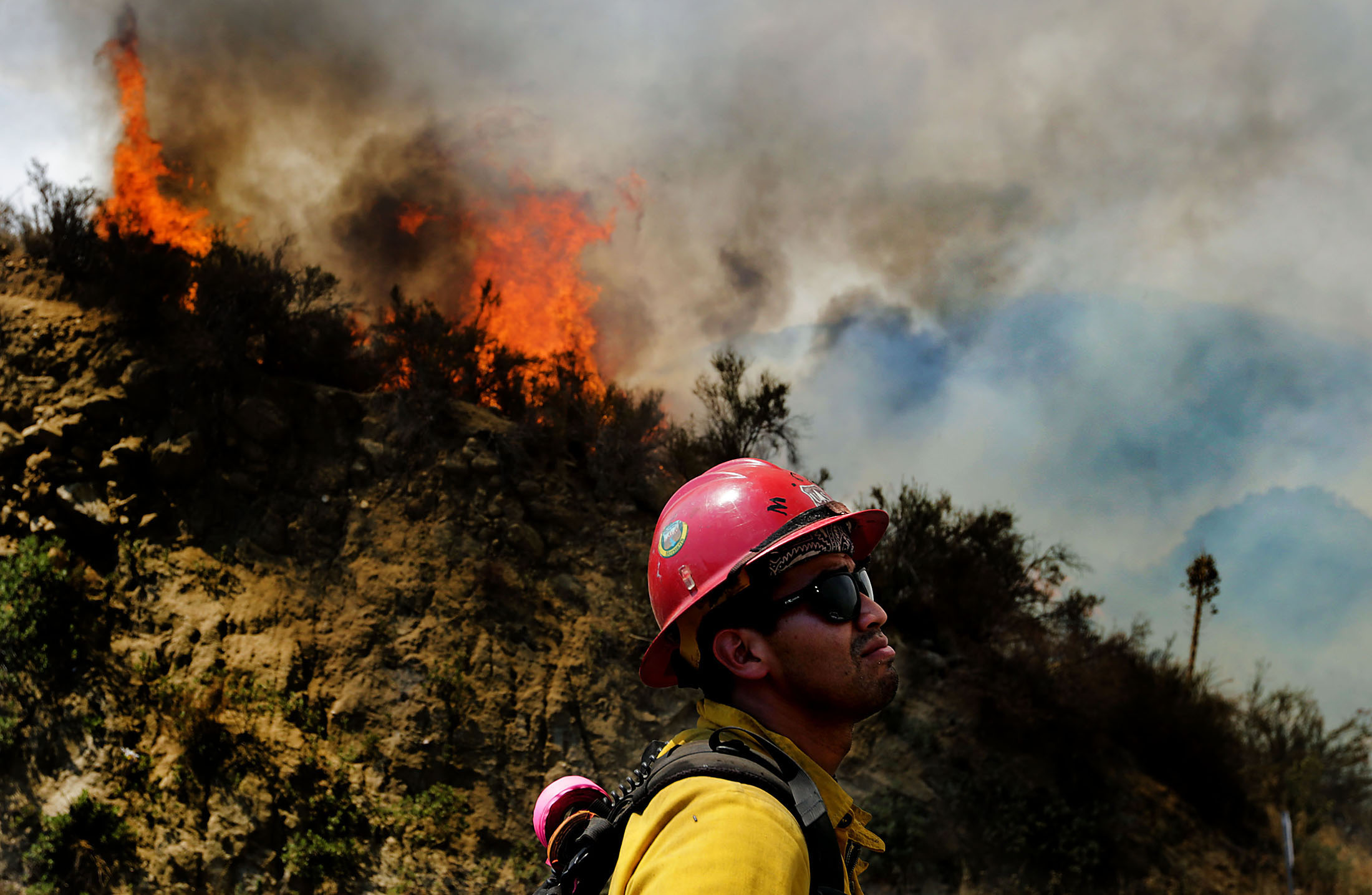 A Hotshot firefighter watches as Cranston fire grows to over 1,200 acres in the San Bernardino National Forest above Hemet on Wednesday, July 25, 2018.