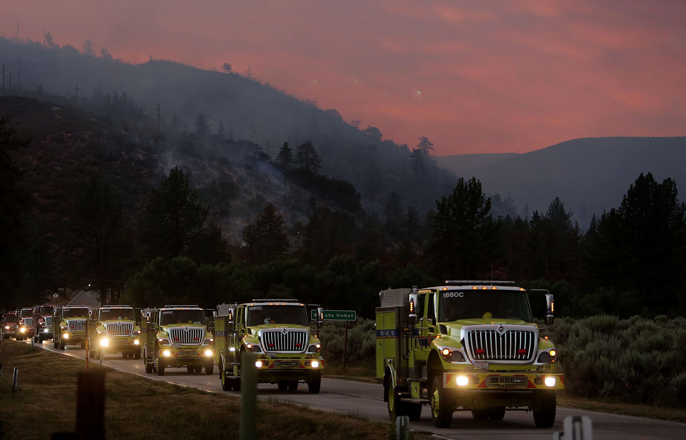 Brush trucks make their way along HWY 74 after battling the Cranston fire in Mountain Center area in the San Bernardino National Forest in Lake Hemet on Thursday, July 26, 2018.