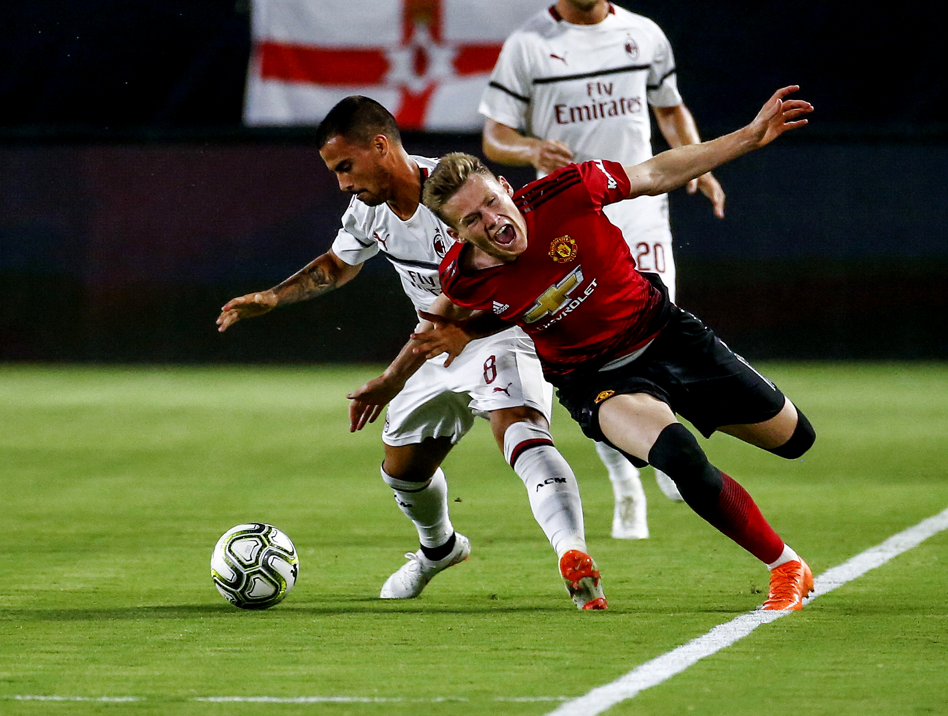 AC Milan's forward Suso (L) vies with Manchester United's midfielder Scott McTominay during the International Champions Cup match on July 25, 2018 in Carson, California, the United States. Manchester United won 9-8 in a penalty shootout.