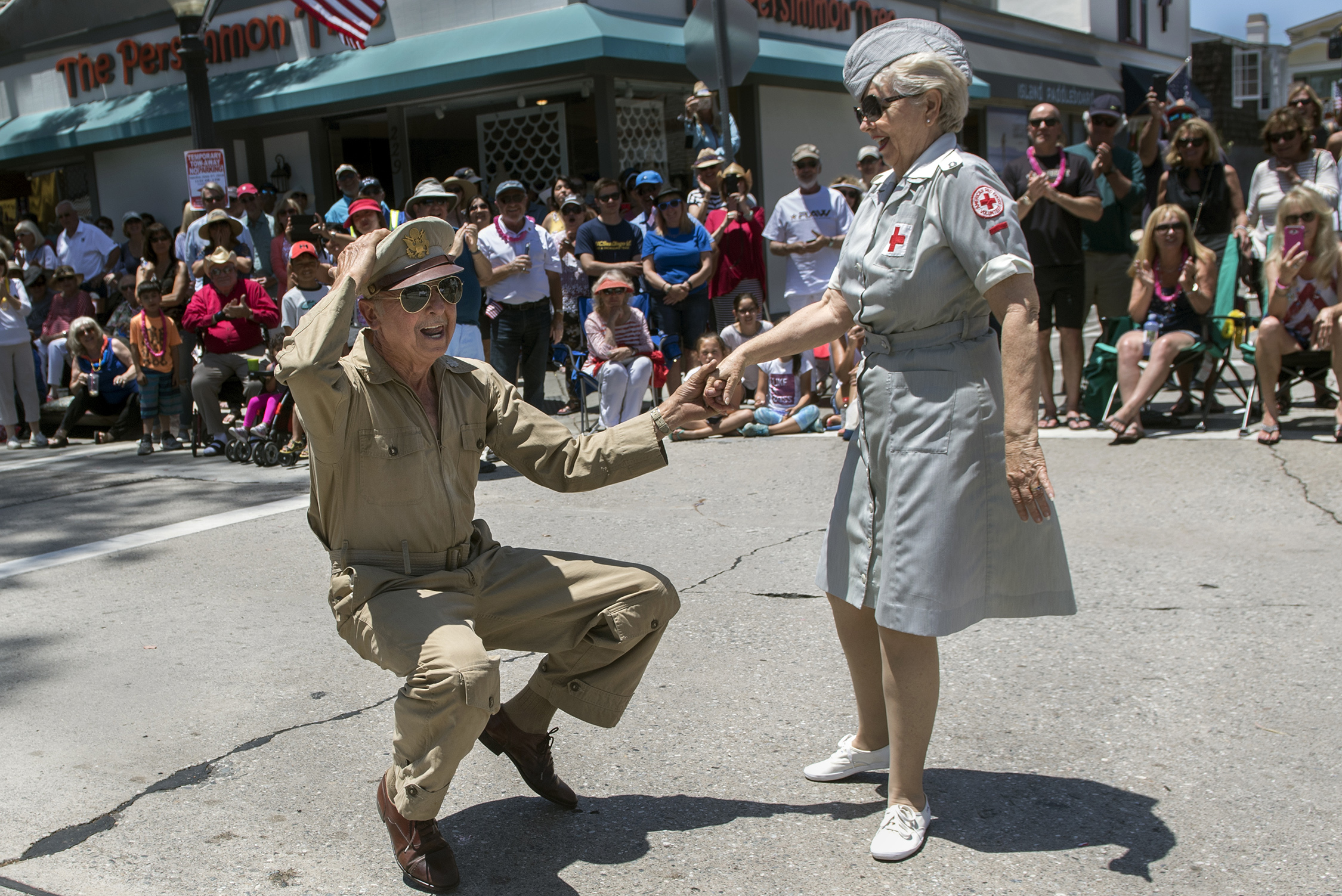 Cornell Iliescu and his swing dance partner Pat Wilke, revive history during the Balboa Island Parade in Newport Beach on Sunday, Jun  3, 2018
