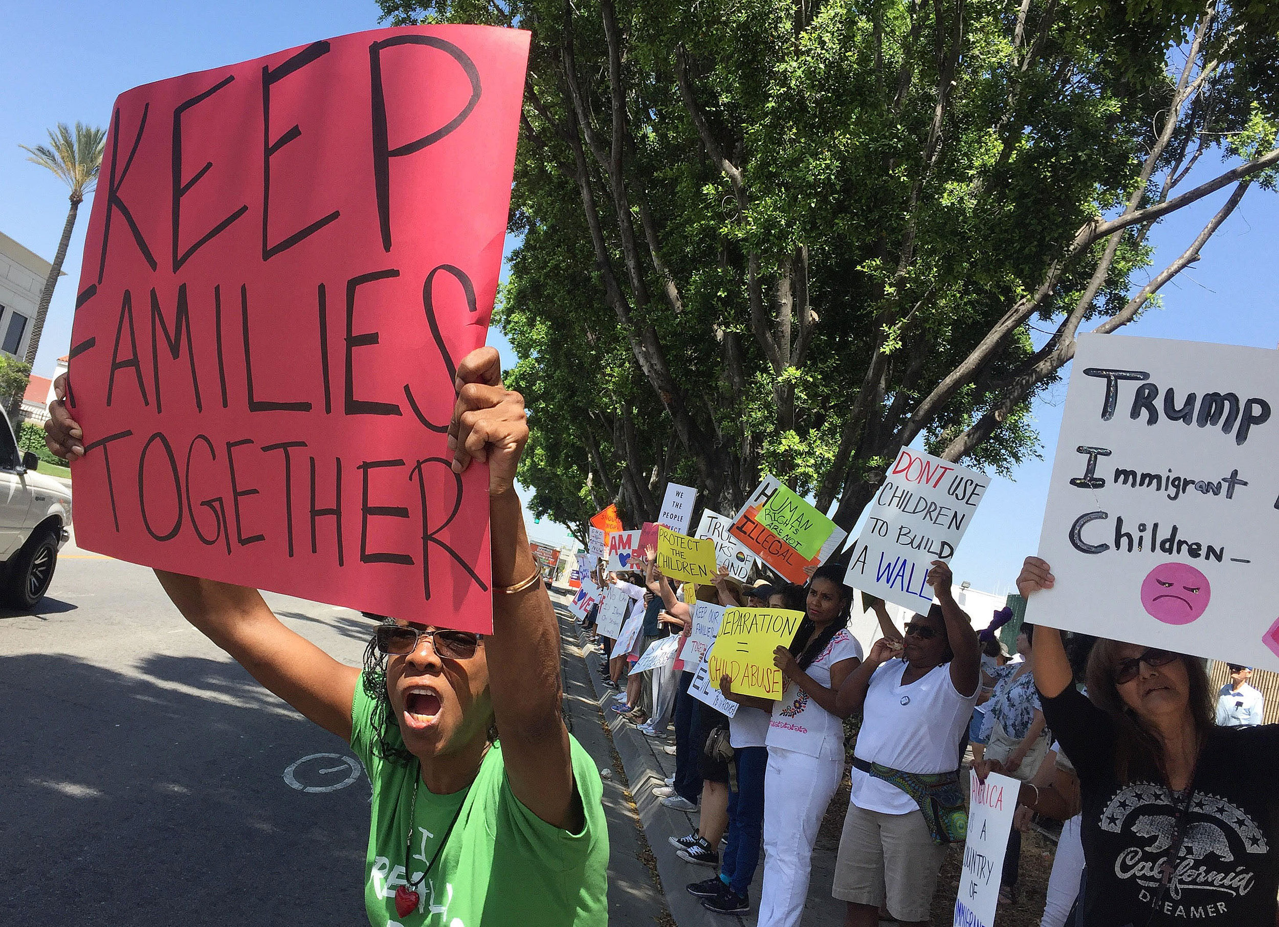 Dr. Carise Charles, from Highland, shouts as she joined approximately 450 other protesters who took part in a Families Belong Together rally outside the office of Homeland Security in San Bernardino on Saturday, June 30, 2018. The peaceful group gathered in support of immigrant families that have been separated by federal agents under U.S. policy.