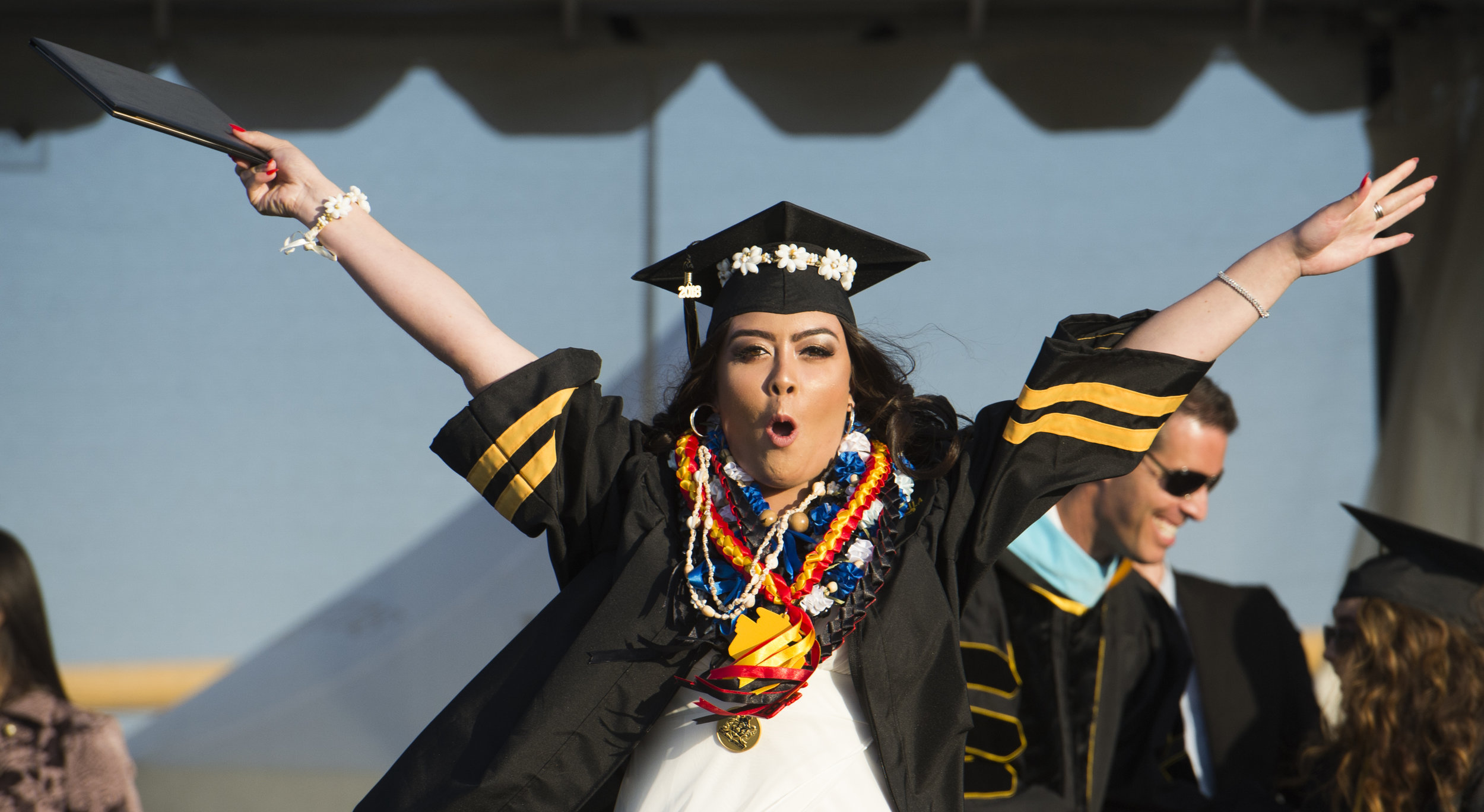 Alexis West celebrates after getting her diploma during the Peninsula High School graduation ceremony in Rolling Hills Estates, Thursday, June 7, 2018. Peninsula graduated 598 students this year.
