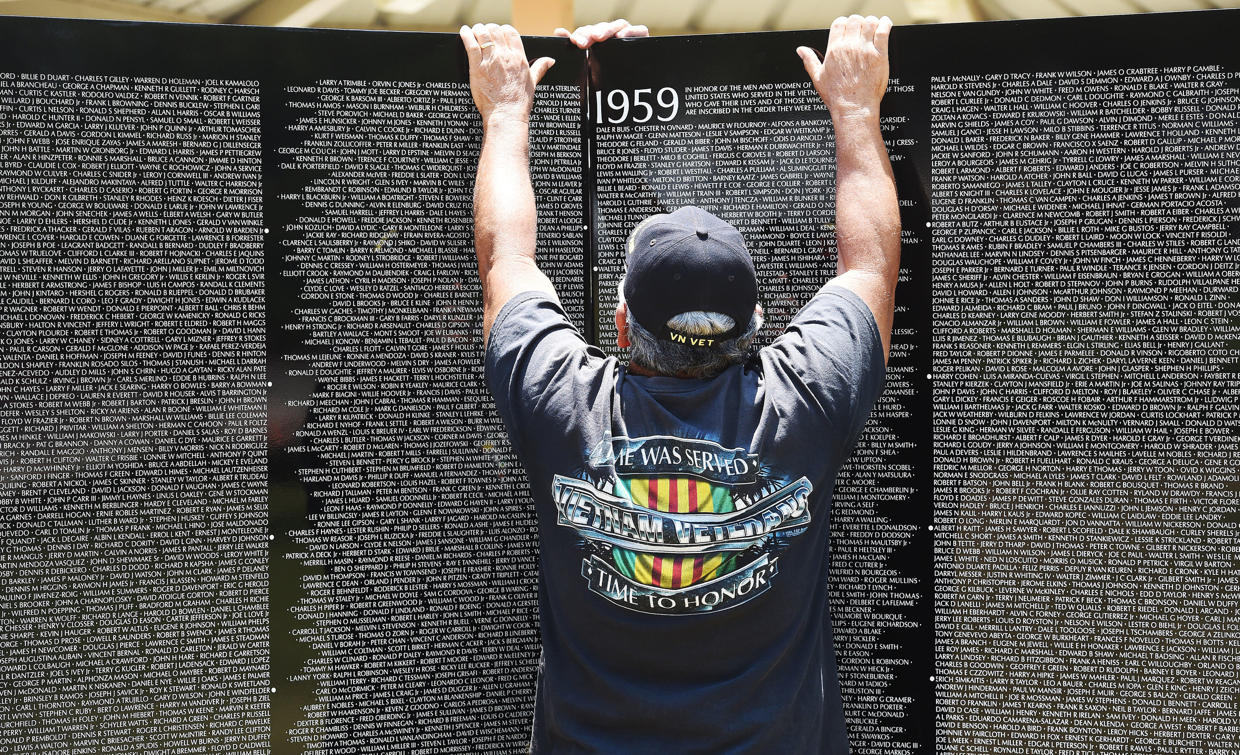 Vietnam Marine veteran Ruben Luis, 69 from San Bernardino, helps install the first two panels of the Vietnam Moving Wall Thursday at Ayala Park in Bloomington. Volunteers, many being Vietnam veterans, helped construct the Vietnam Moving Wall in Ayala Park in Bloomington Thursday June 7, 2018. The wall, containing 58,318 names, with 132 being from San Bernardino County, will be on display 24-hours a day beginning Friday and lasting through Monday.