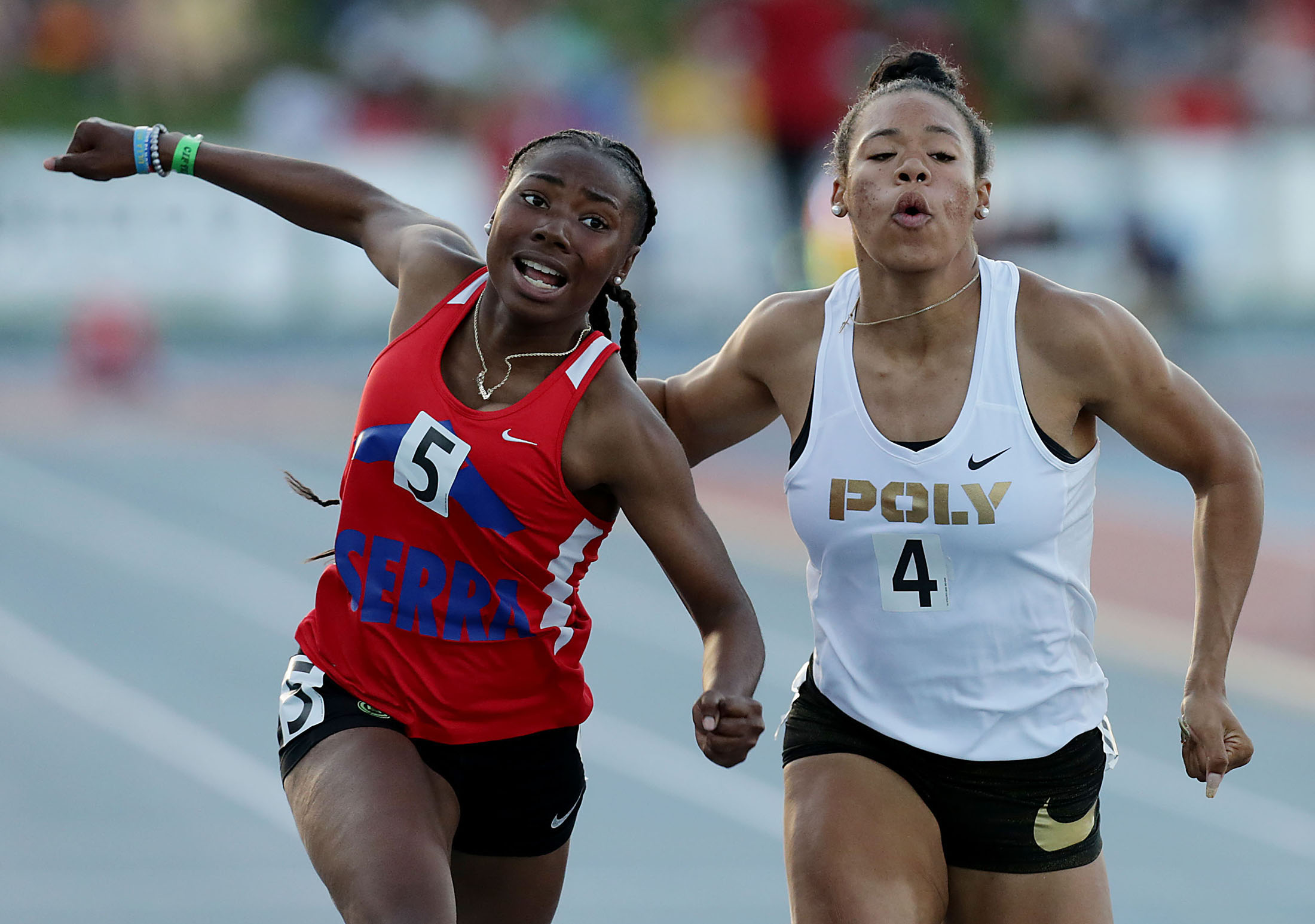 La Sierra�s Mariah Allain and Long Beach Poly�s Ariyonna Augustine compete in the 100 yard dash during the 100th annal CIF State Track and Field Championships at Buchanan High Saturday in Clovis, Calif. June 2, 2018.