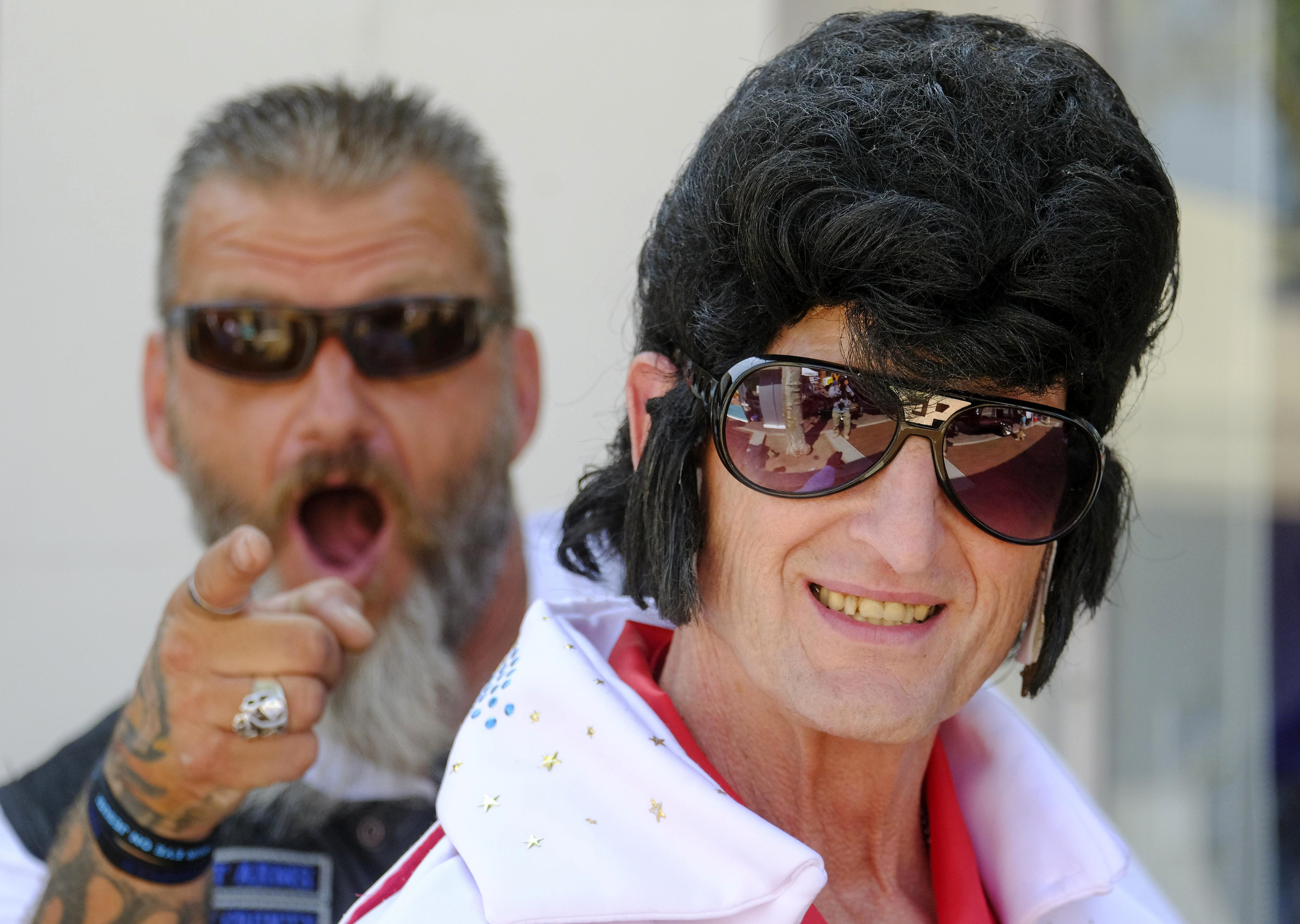 A fan dressed as Elvis Presley poses for pictures in the 19th annual Elvis Festival to tribute the King of Rock N' Roll on Sunday August 26, 2018 in Garden Grove, California, the United States.