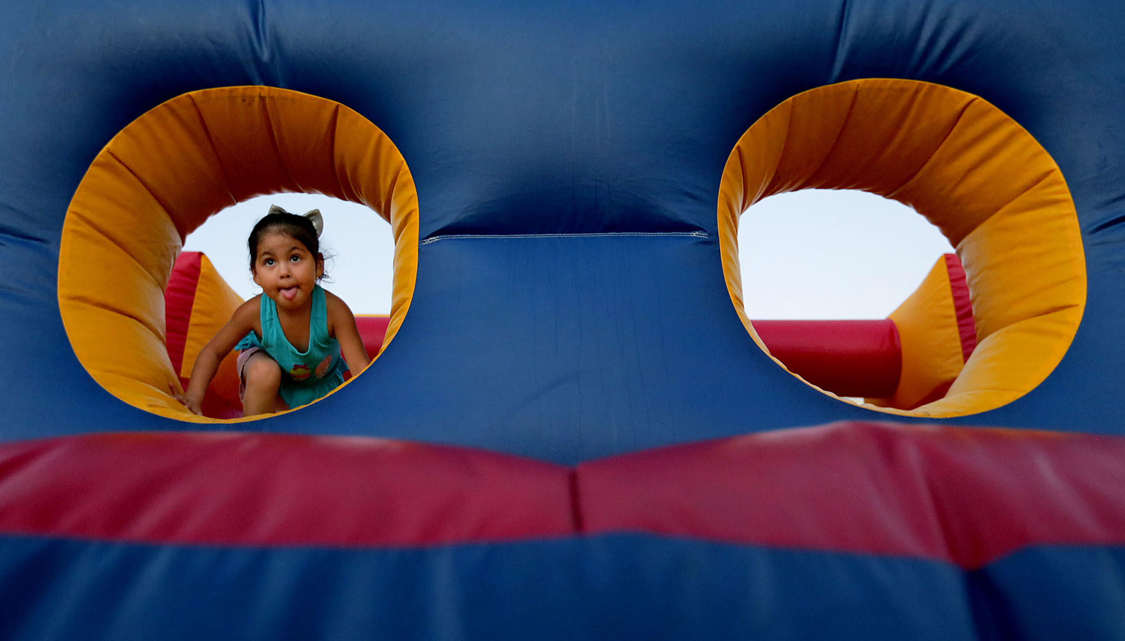 Kids play in the fun zone during Moreno Valley summer concert and movie series at the Conference and Recreation Center in Moreno Valley on Friday, August 3, 2018.