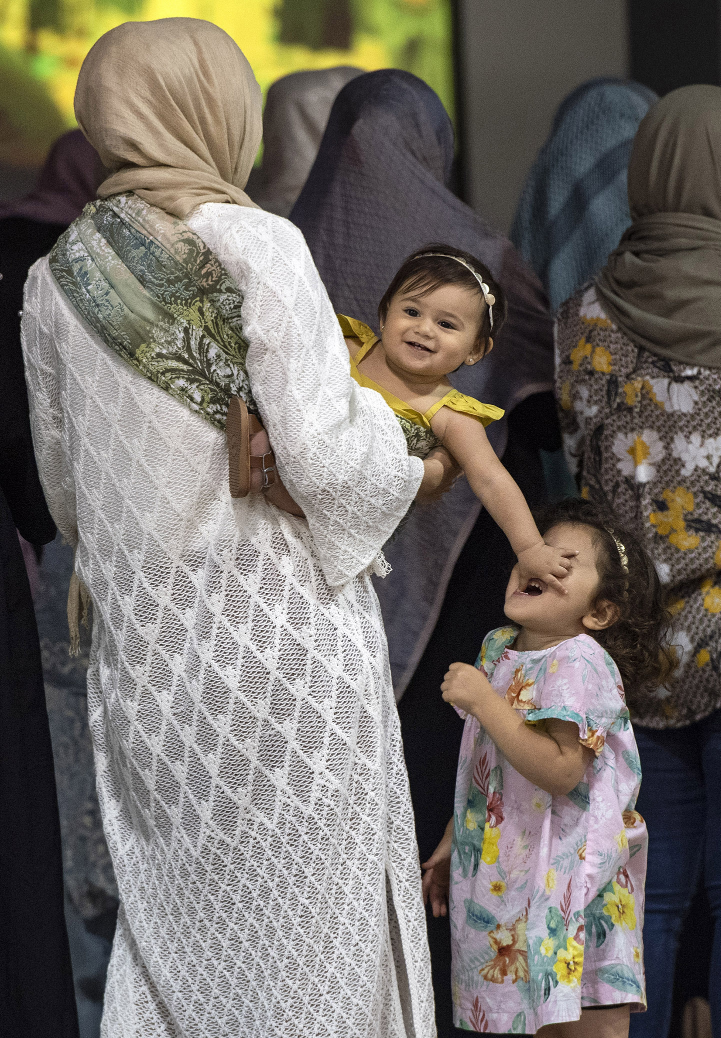 """Children are caught in their own playful world as they attend the celebration of the end of Hajj in Anaheim Tuesday, August 21, 2018. The prayers and the holiday that follows are called Eid ul-Adha or """"Festival of the Sacrifice."""""""