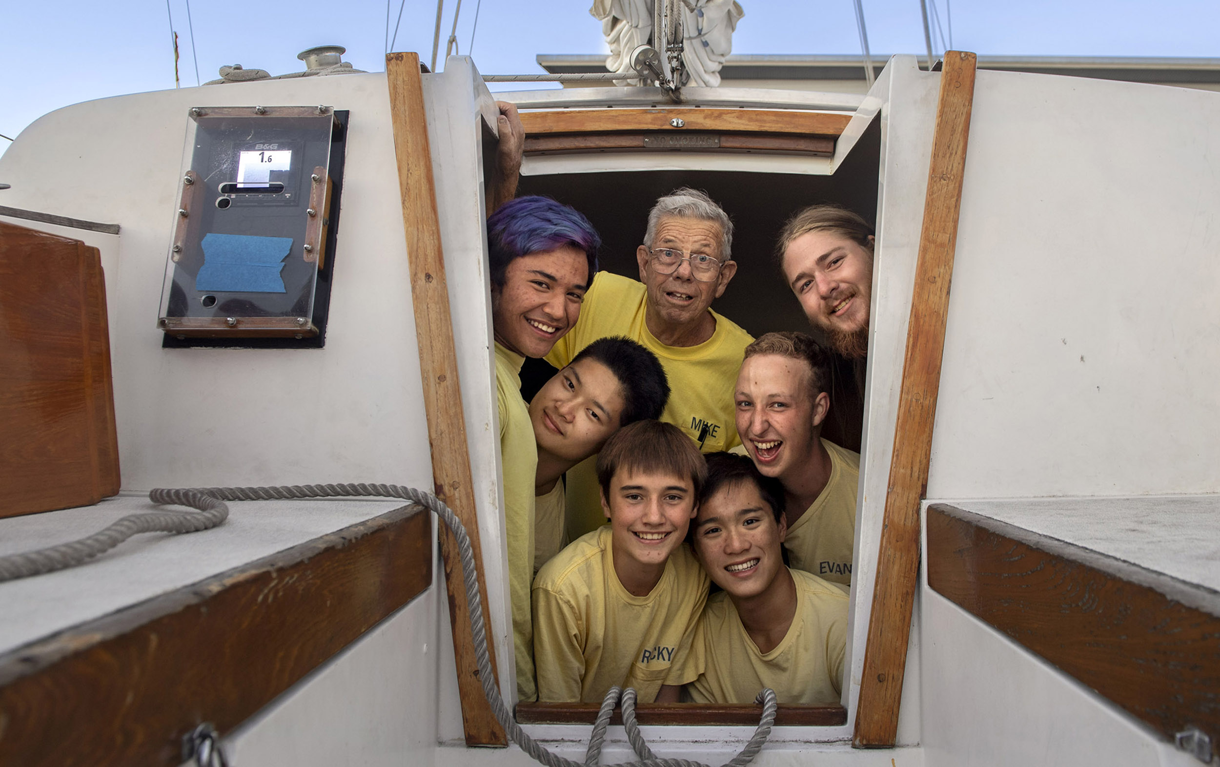 Volunteer Mike Stewart celebrates 55 years as skipper of Sea Scout Ship 711 or Del Mar, where he mentors Boy Scouts in the maritime program. He has taught 700 boys including this current group, clockwise from top left: Josh Timmerman, 19, Nicholas Ryti, 19, Evan Mack, 18, Duy Nguyen, 16, Ricky Kramer, 14, and Ted Xiag, 17, in Newport Beach on Wednesday, August 29, 2018.