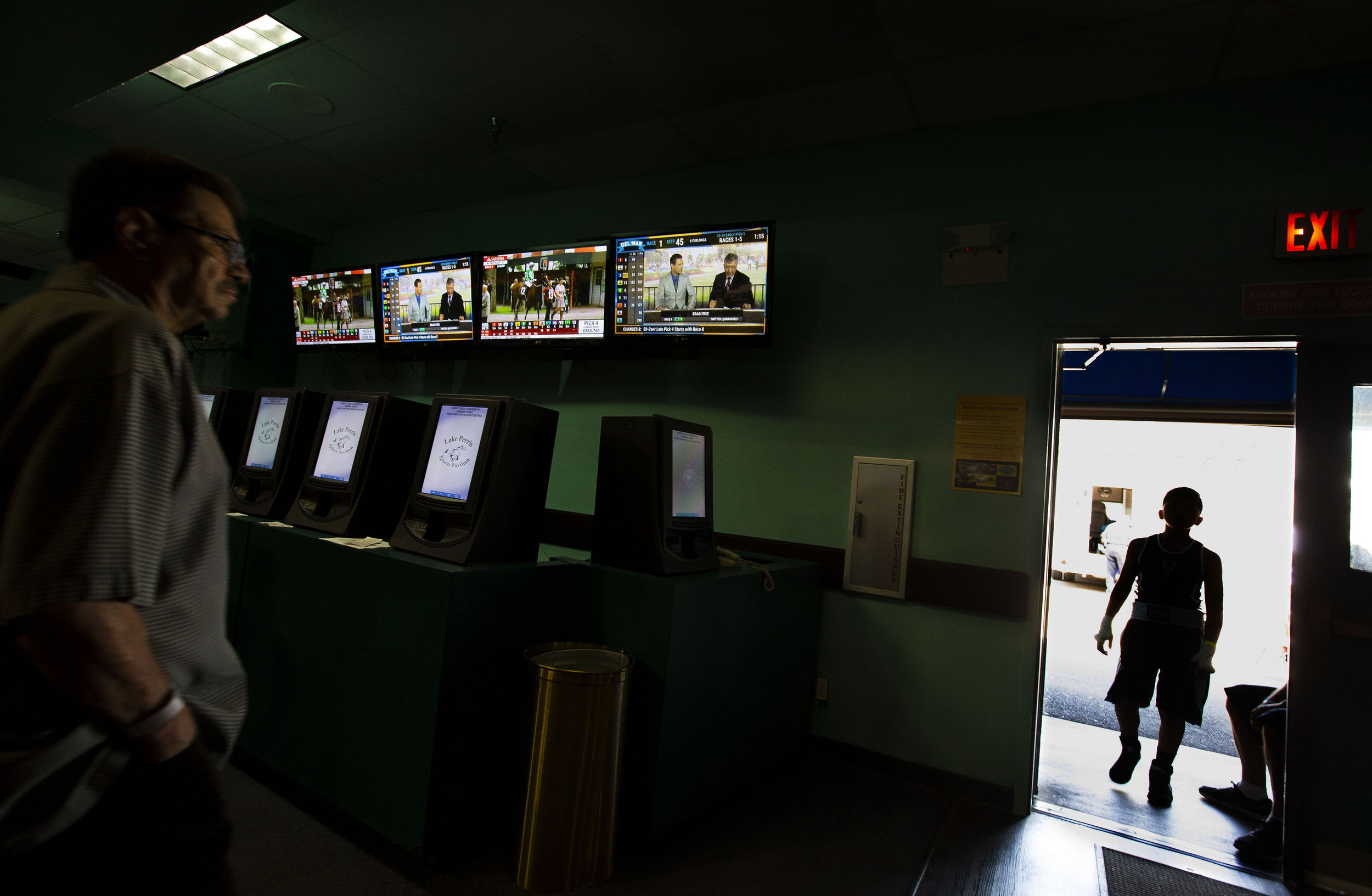 A boxer makes his way into the pavilion after having his hands taped during the Future Olympics Champions at  Lake Perris Sports Pavilion in Perris on Saturday, August 18, 2018.