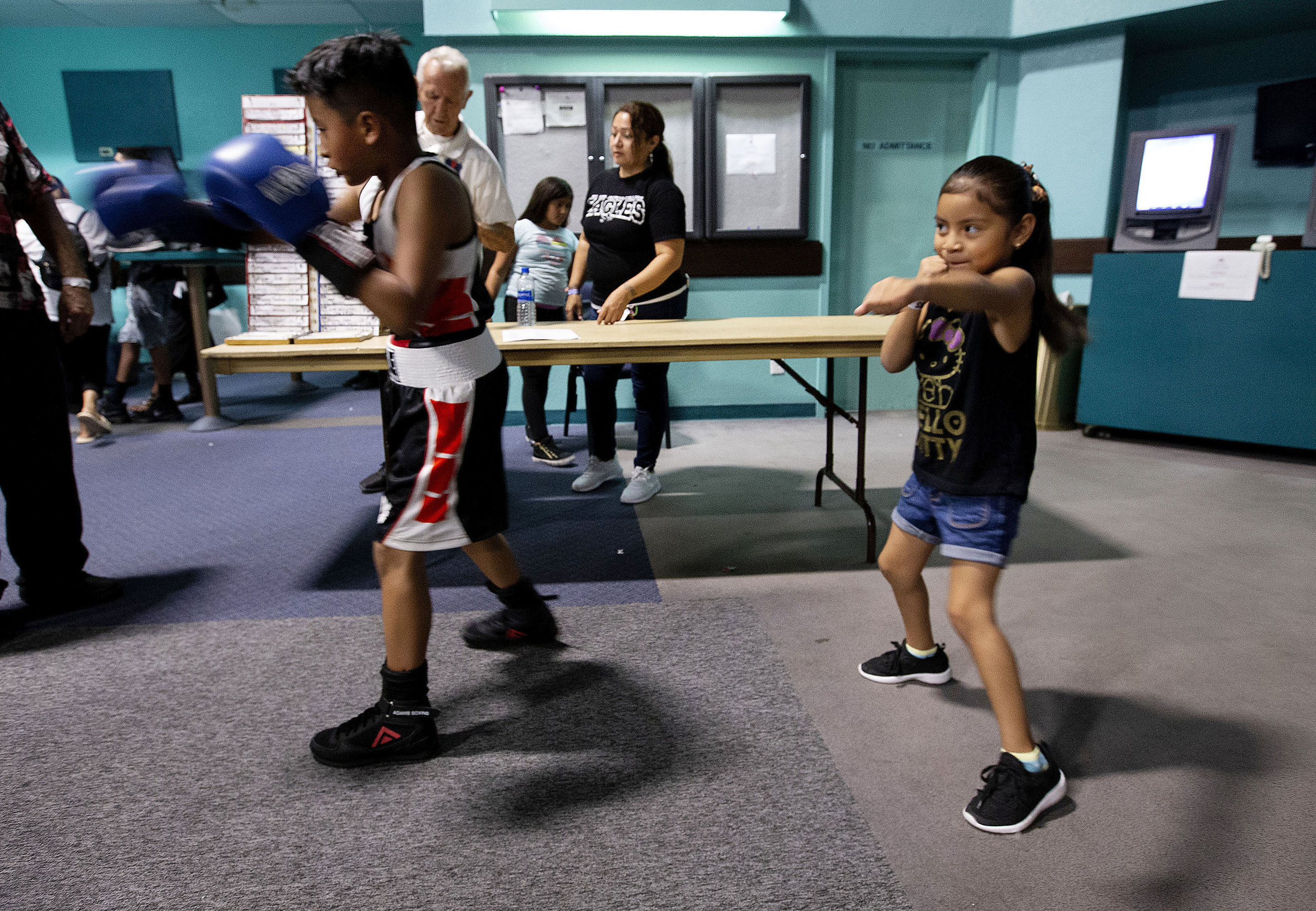 United Boxing Academy boxer Evan Nahuat, 9, left shadow boxes as does his sister Mia Nahuat, 5, both of Moreno Valley minutes before his bout during the Future Olympics Champions at  Lake Perris Sports Pavilion in Perris on Saturday, August 18, 2018.
