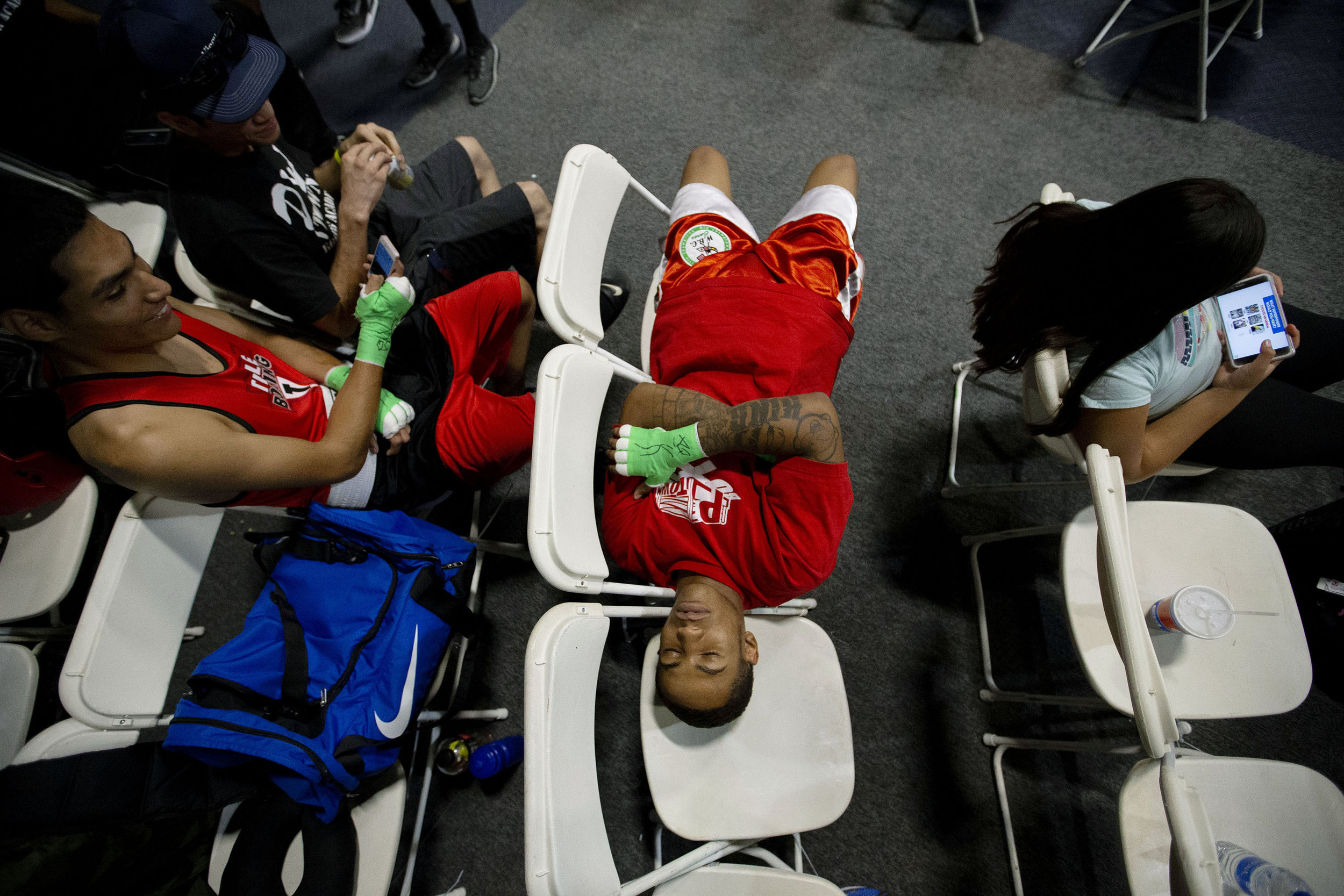 P-Town Boxing's William King finds time nap as he waits for his bout which is the 15th of the day during the Future Olympics Champions at  Lake Perris Sports Pavilion in Perris on Saturday, August 18, 2018.