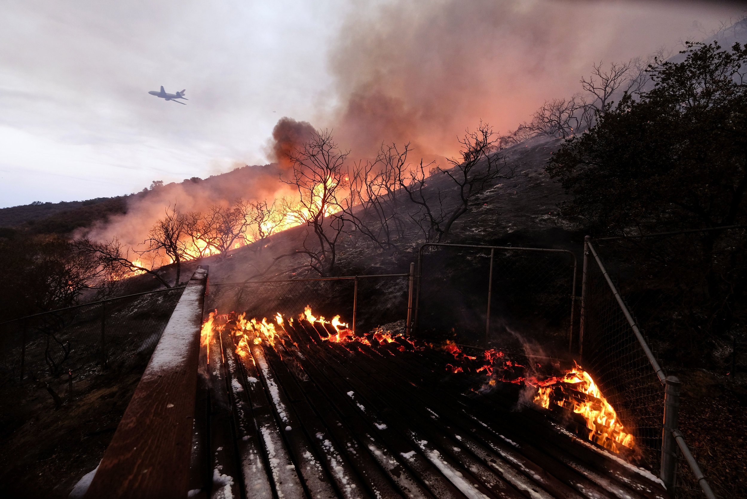 The Holy Fire burns at a home's back yard in the Cleveland National Forest in Lake Elsinore, Calif., Thursday, Aug. 9, 2018.