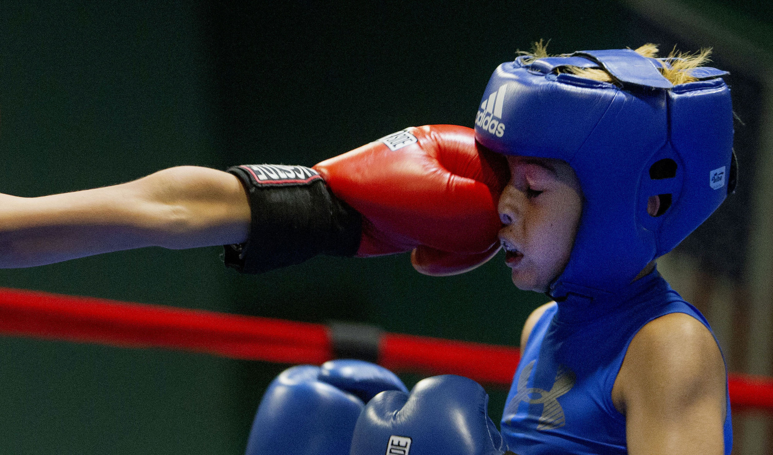 FTP Boxing's Jacob Garcia, 9, of Moreno Valley lands a jab to the face of Compton Boxing's Carlos Ponce, 9, during the Future Olympics Champions at  Lake Perris Sports Pavilion in Perris on Saturday, August 18, 2018.