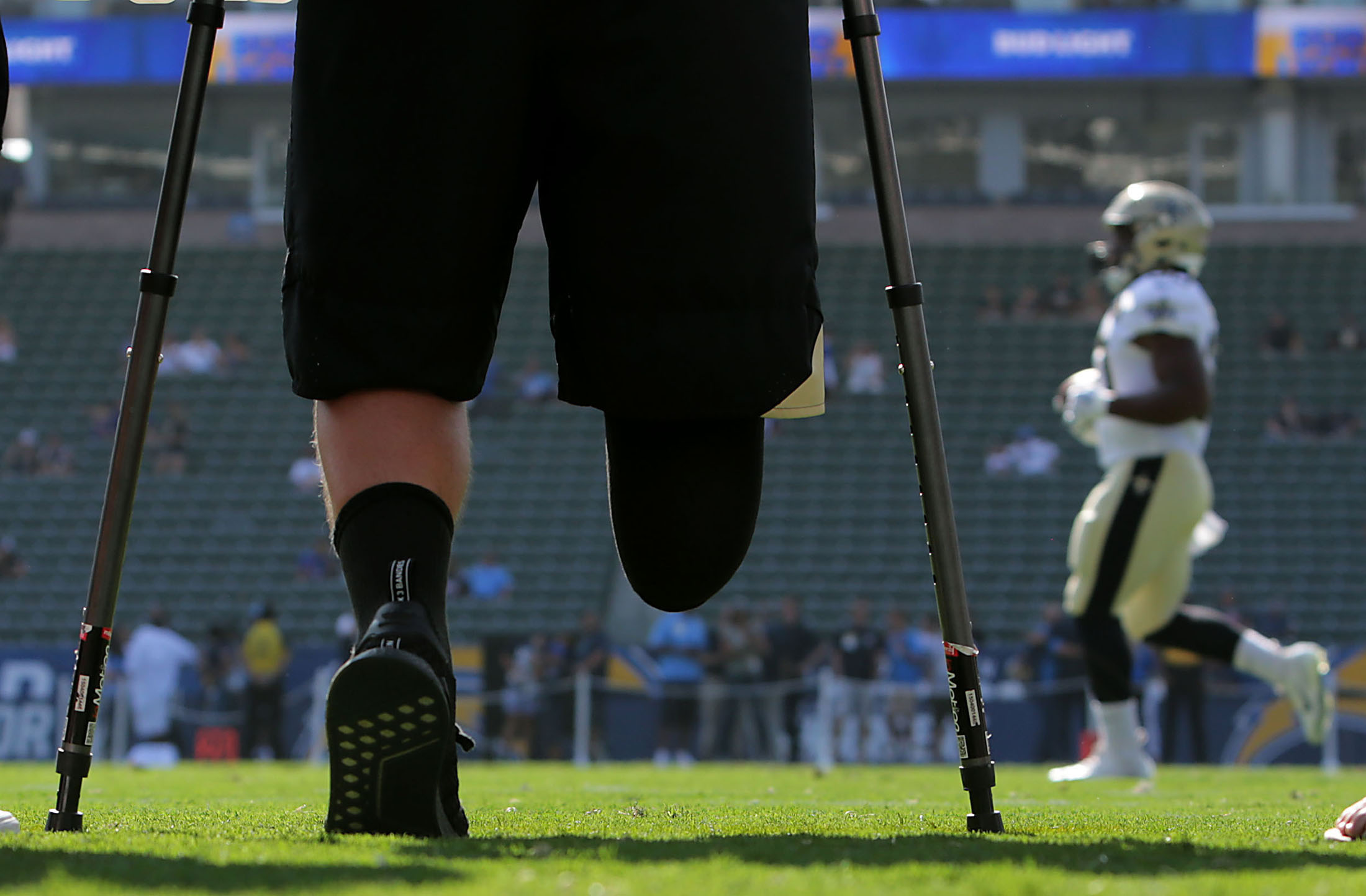 After meeting New Orleans Saints quarterback Drew Brees at practice two days earlier Alex Ruiz, the Temecula high school quarterback who chose to amputate a portion of his right leg after sustaining an on-field injury last year, watches the Saints warmup from the sidelines before the preseason game against the Los Angeles Chargers at StubHub Center  in Carson on Saturday, August 25, 2018.