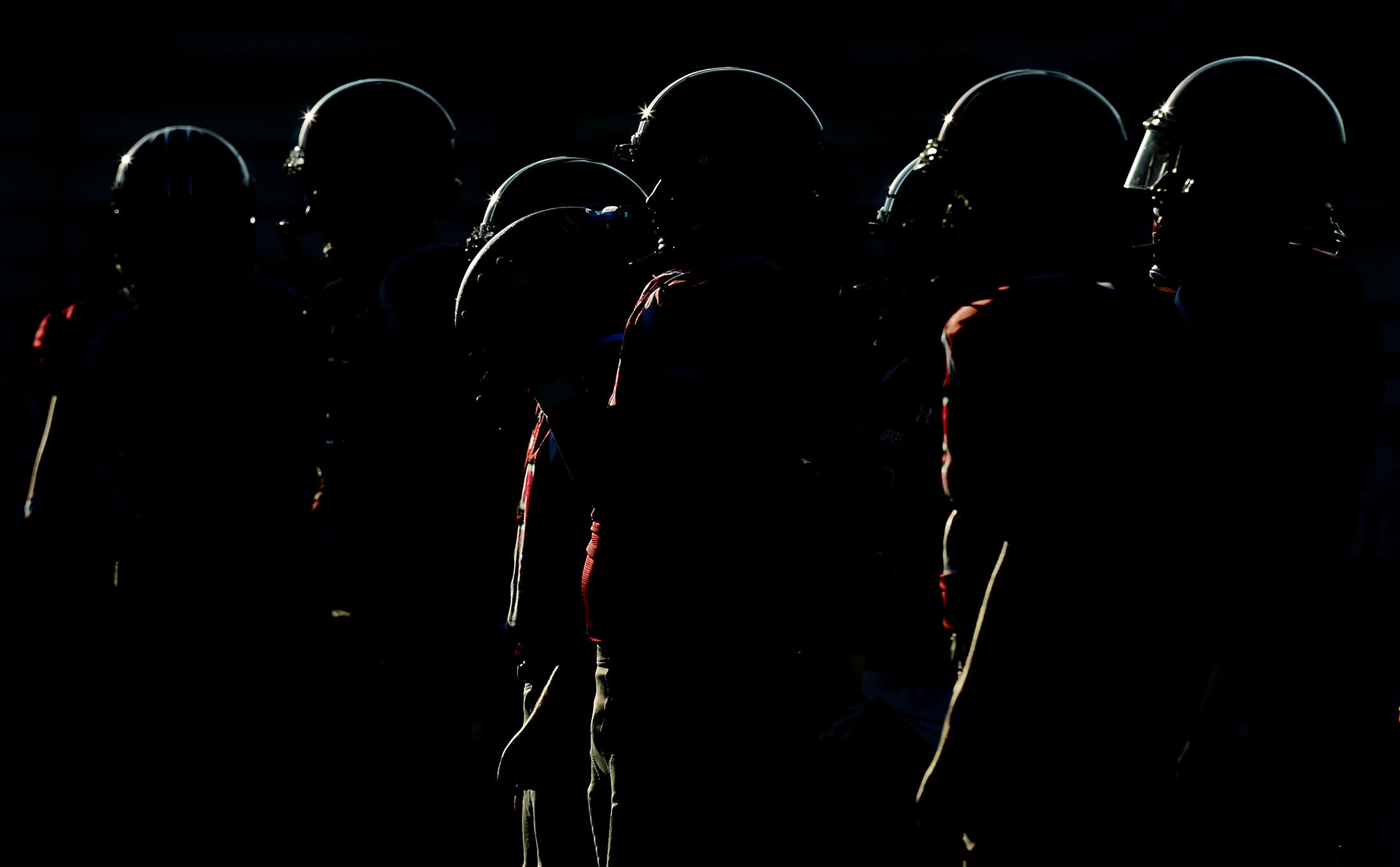 Patriot players are silhouetted as they warm up before playing Rubidoux in a non league game between district rivals in Jurupa Valley on Friday, August 24, 2018.