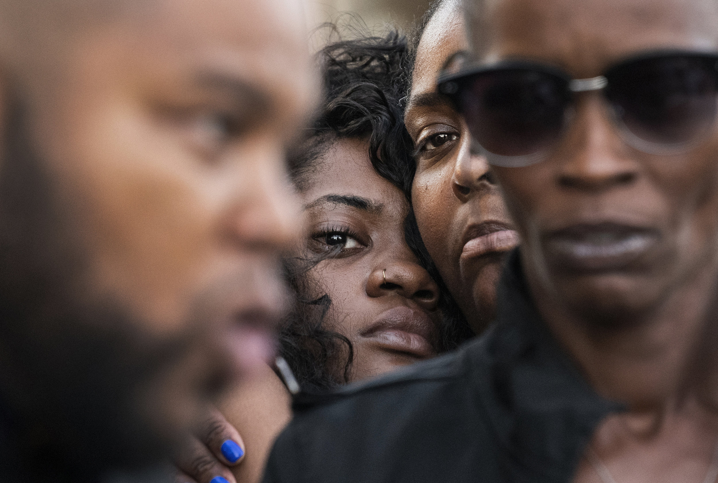 Friends, family, and community members comfort each other as they gather for a vigil for Guy Alford III, 20, who was shot and killed in a drive-through fast food restaurant the two nights before In Long Beach September 27, 2018.