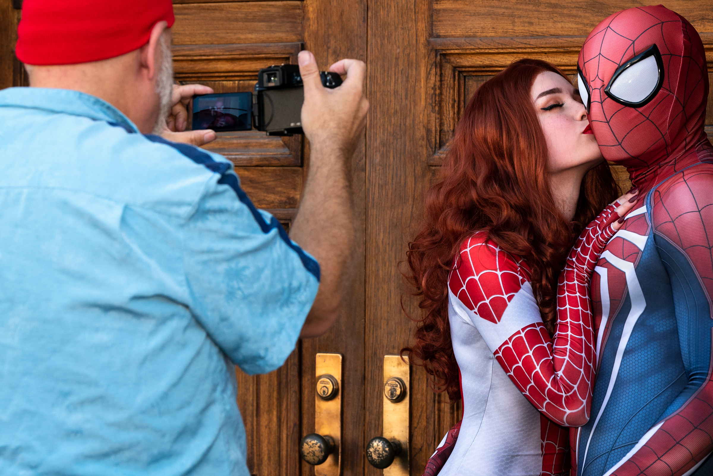 A man takes a picture of cosplayers during Nerdbot Con, a cospla