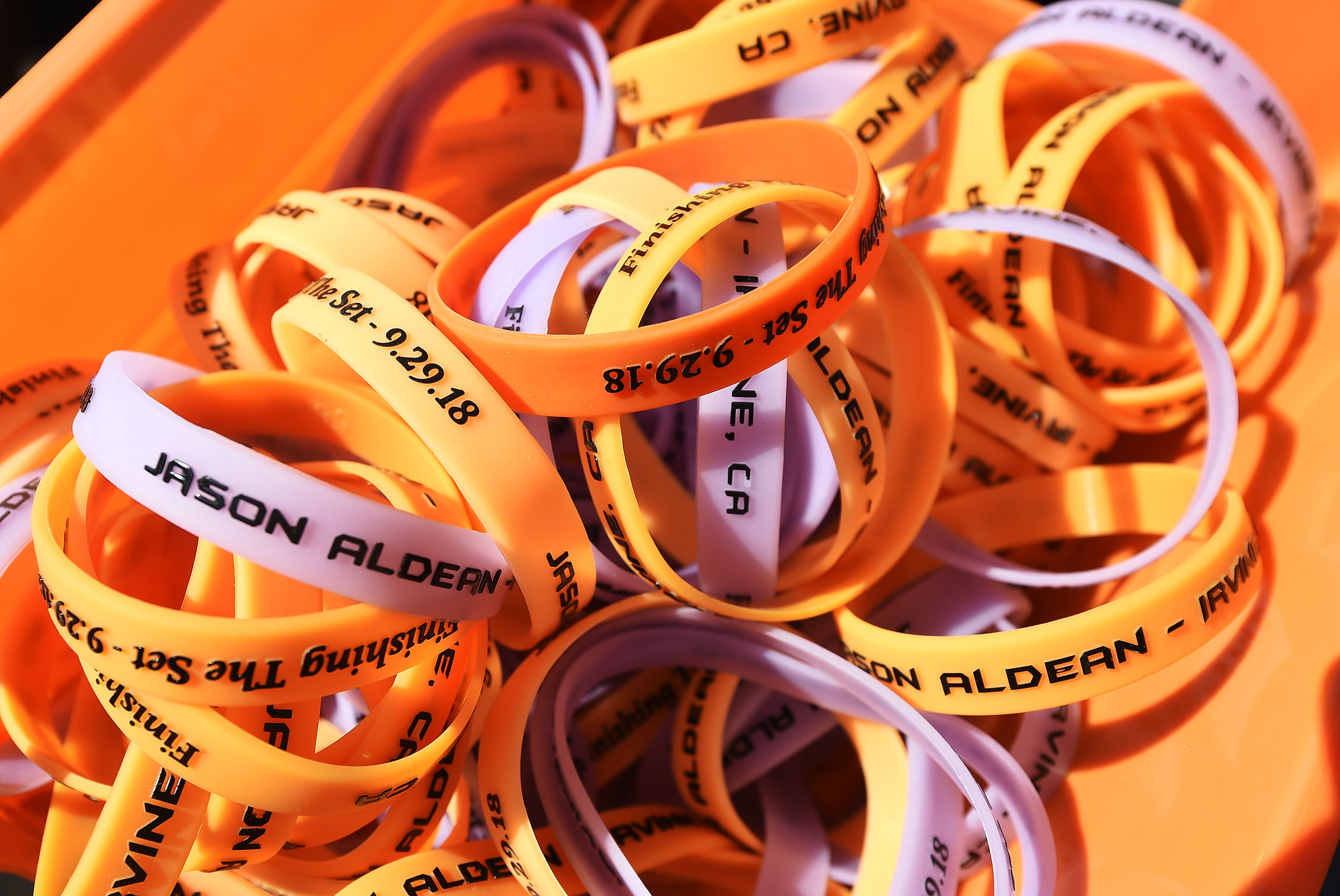 Some of the wristbands handed out by Route 91 Harvest Festival survivor Lisa Freeman Wehring sit in a tray prior to country music artist Jason Aldean's performance Saturday, September 29, 2018 at FivePoint Amphitheatre in Irvine. Approximately 500 Route 91 survivors attended the show. Aldean was on stage in Las Vegas last October 1 when a gun man shot and killed 58 concert goers at the Route 91 Harvest Festival.