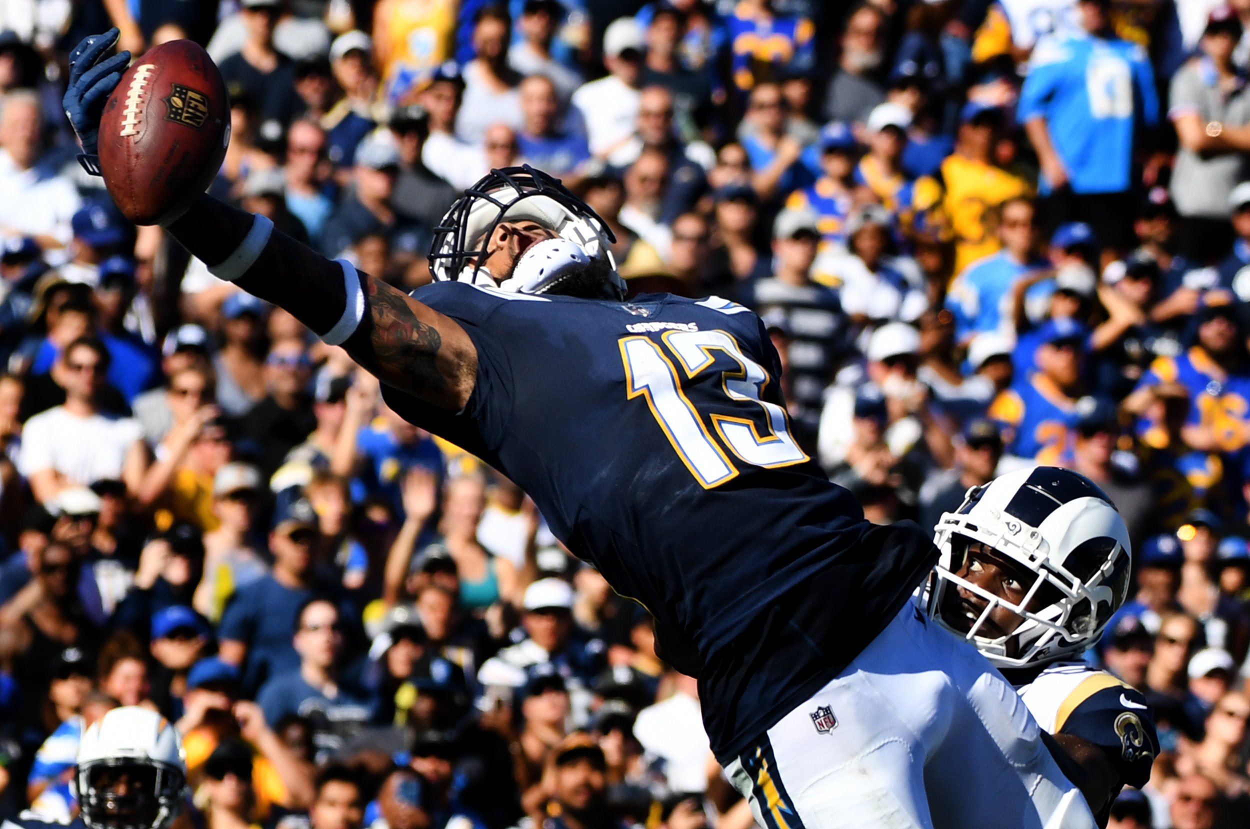 Wide receiver Keenan Allen #13 of the Los Angeles Chargers can't hold onto a pass in the end zone against the Los Angeles Rams in the second half of a NFL football game at the Los Angeles Memorial Coliseum on Sunday, September 23, 2018 in Los Angeles, California. Los Angeles Rams won 35-23.