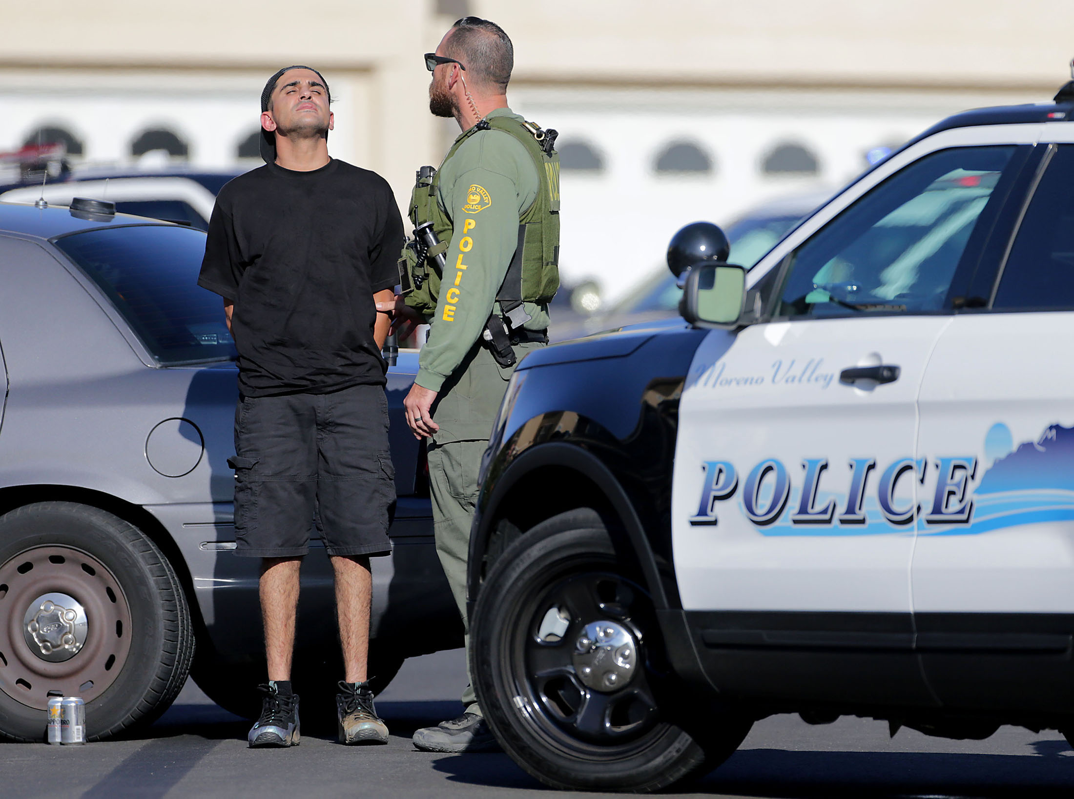 A suspect is detained by Moreno Valley police after a shooting was reporter at Sugarite Canyon Drive and Soccoro Drive in Moreno Valley on Thursday, September 6, 2018. No one was hurt in the late afternoon shooting but one car was reporter hit by the gun fire.