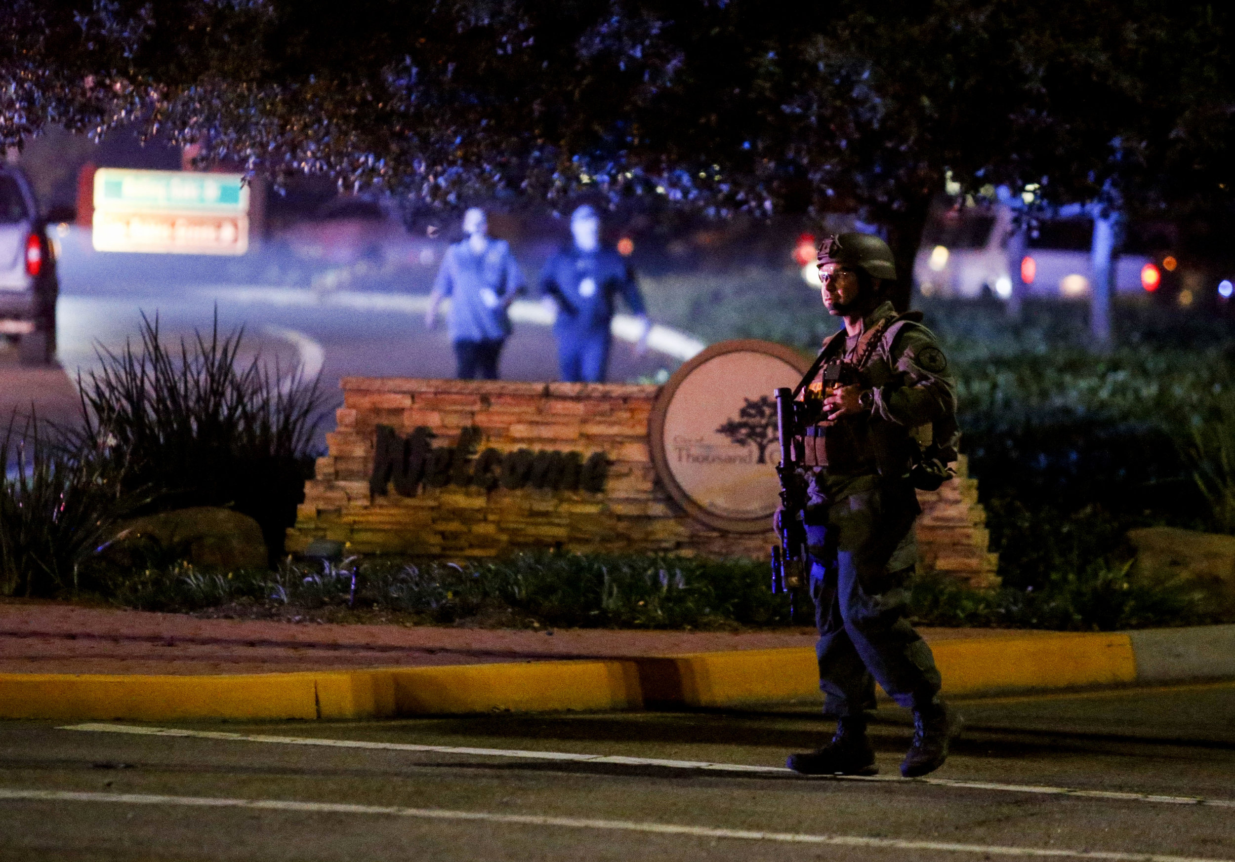 A police officer secures the road leading to the Borderline Bar and Grill where a gunman injured 11 people in Thousand Oaks, California, the United State, November 8, 2018.