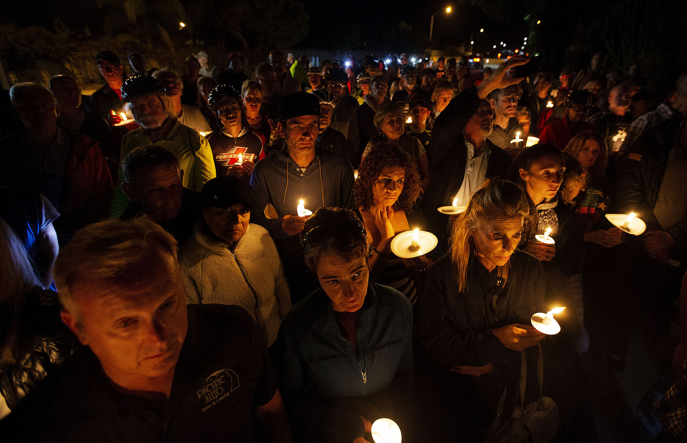 More than 100 people and fellow cyclist attend a candlelight vigil for Leslie Pray, 54, who was killed Saturday while riding her bike along Mills Avenue near Radcliffe Drive in Claremont on Monday, November 5, 2018.