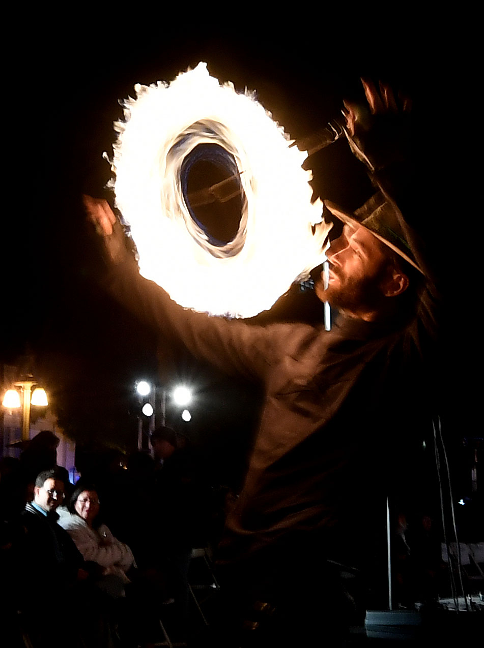 Fire dancer John Routson, from Riverside, performs for those gathered prior to the lighting of the Inland Empire's largest Menorah during the 14th annual Chanukah Festival outside of the Riverside courthouse on Monday evening December 3, 2018.