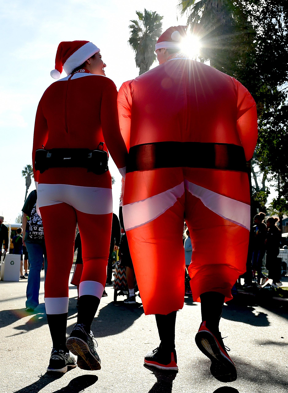 A pair of runners leave after running in the Riverside Reindeer Run Half Marathon at Fairmount Park in Riverside, Sunday morning December 2, 2018.