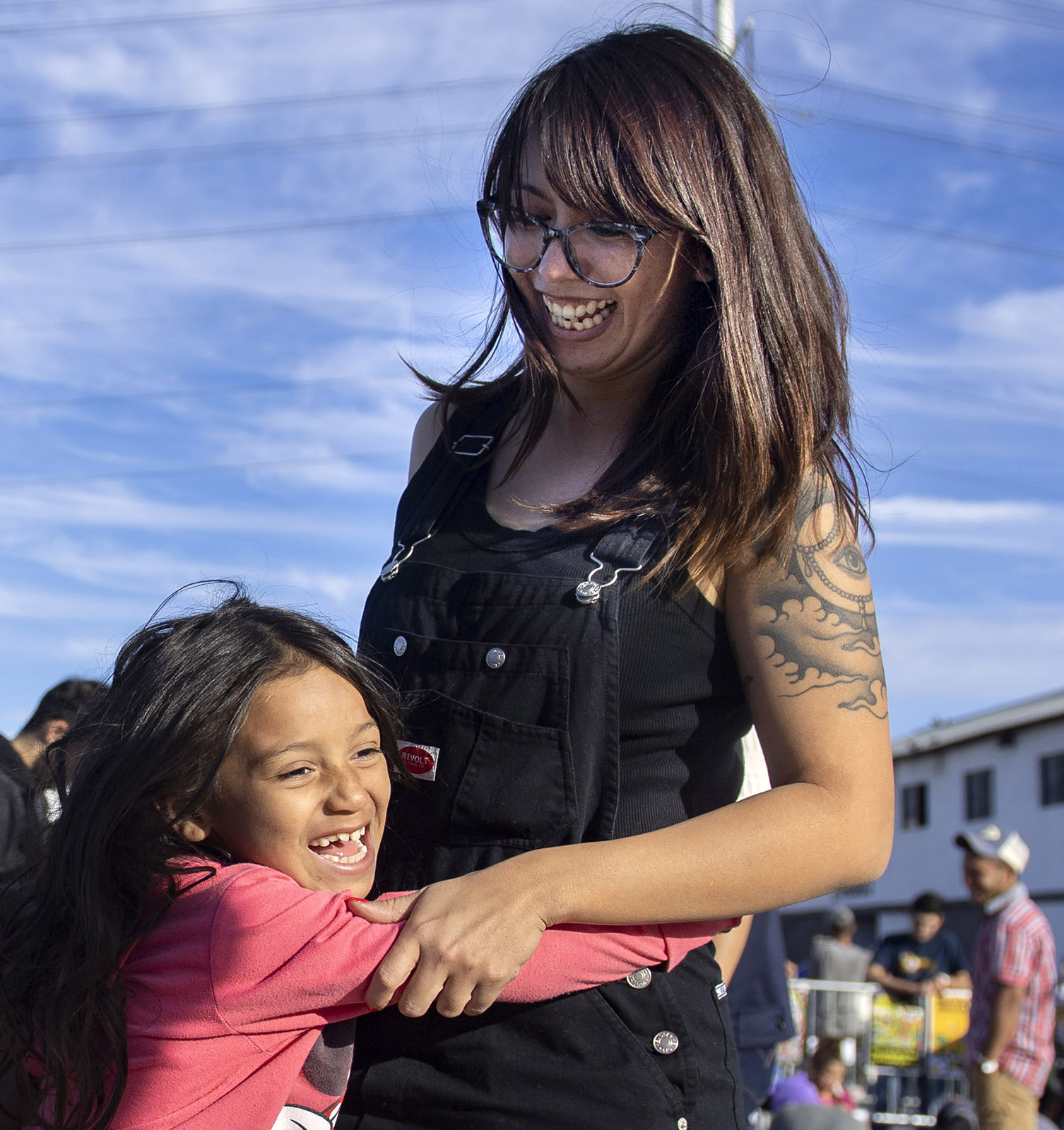 Resa Cole of Los Angeles gets hugged by 8-year-old Ruth, a Honduran migrant outside the El Barretal shelter in Tijuana on Tuesday, December 4, 2018. Cole and her friends have raised more than $15,000 on social media to help the thousands of migrants from Central America.