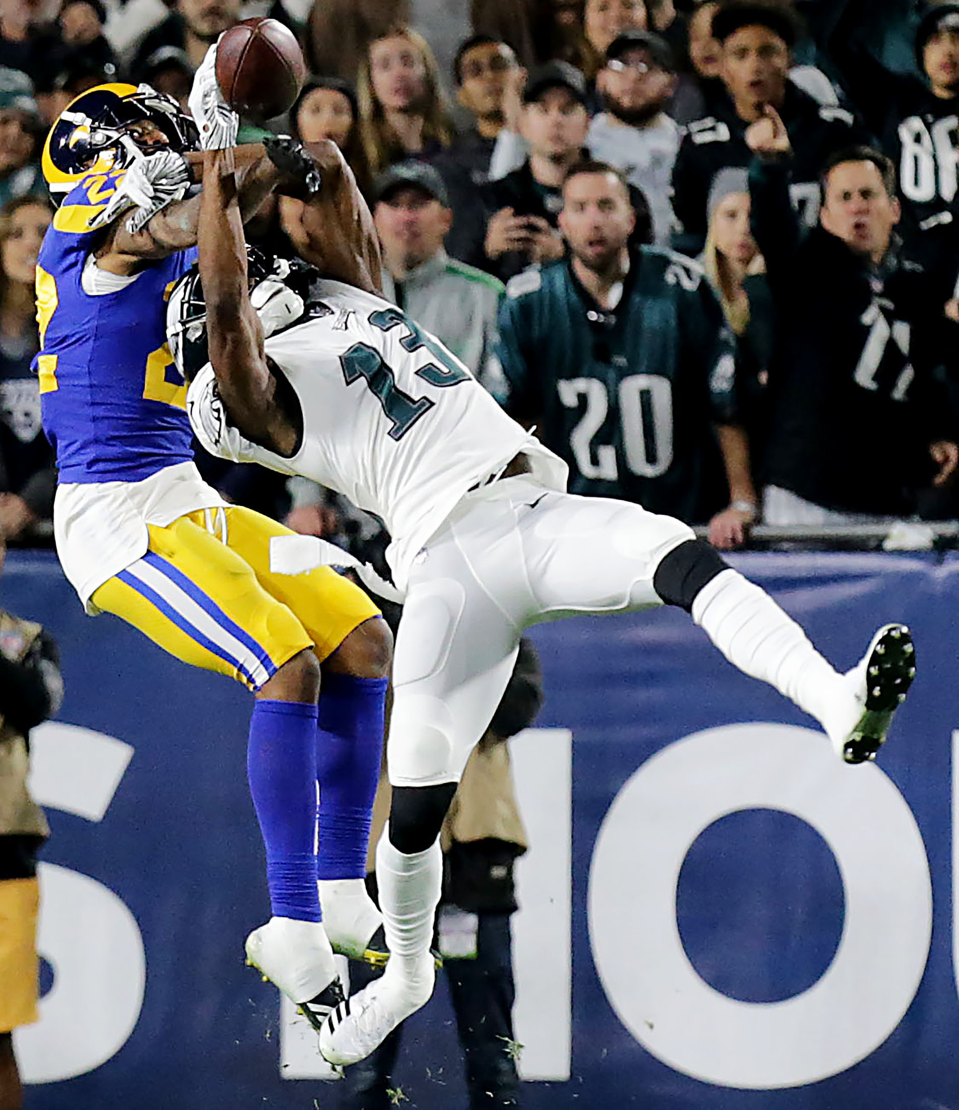 Los Angeles Rams cornerback Marcus Peters #22 breaks up a pass intended for Philadelphia Eagles wide receiver Nelson Agholor #13 in the first half of the game at the Los Angeles Memorial Coliseum in Los Angeles on Sunday, December 16, 2018.
