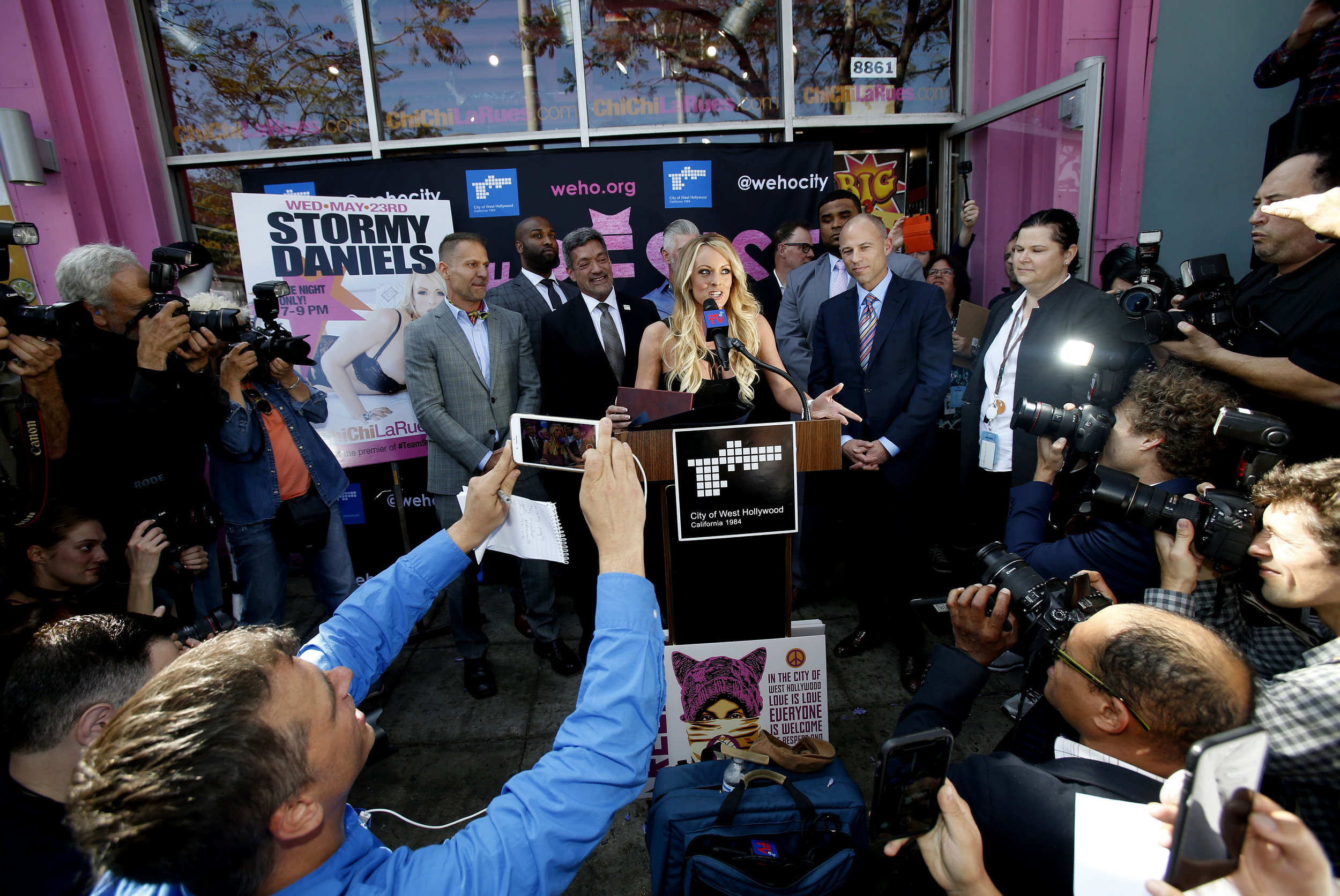 Stormy Daniels, center, speaks during a ceremony for her receiving a City Proclamation and Key to the City on Wednesday, May 23, 2018 in West Hollywood, Calif.