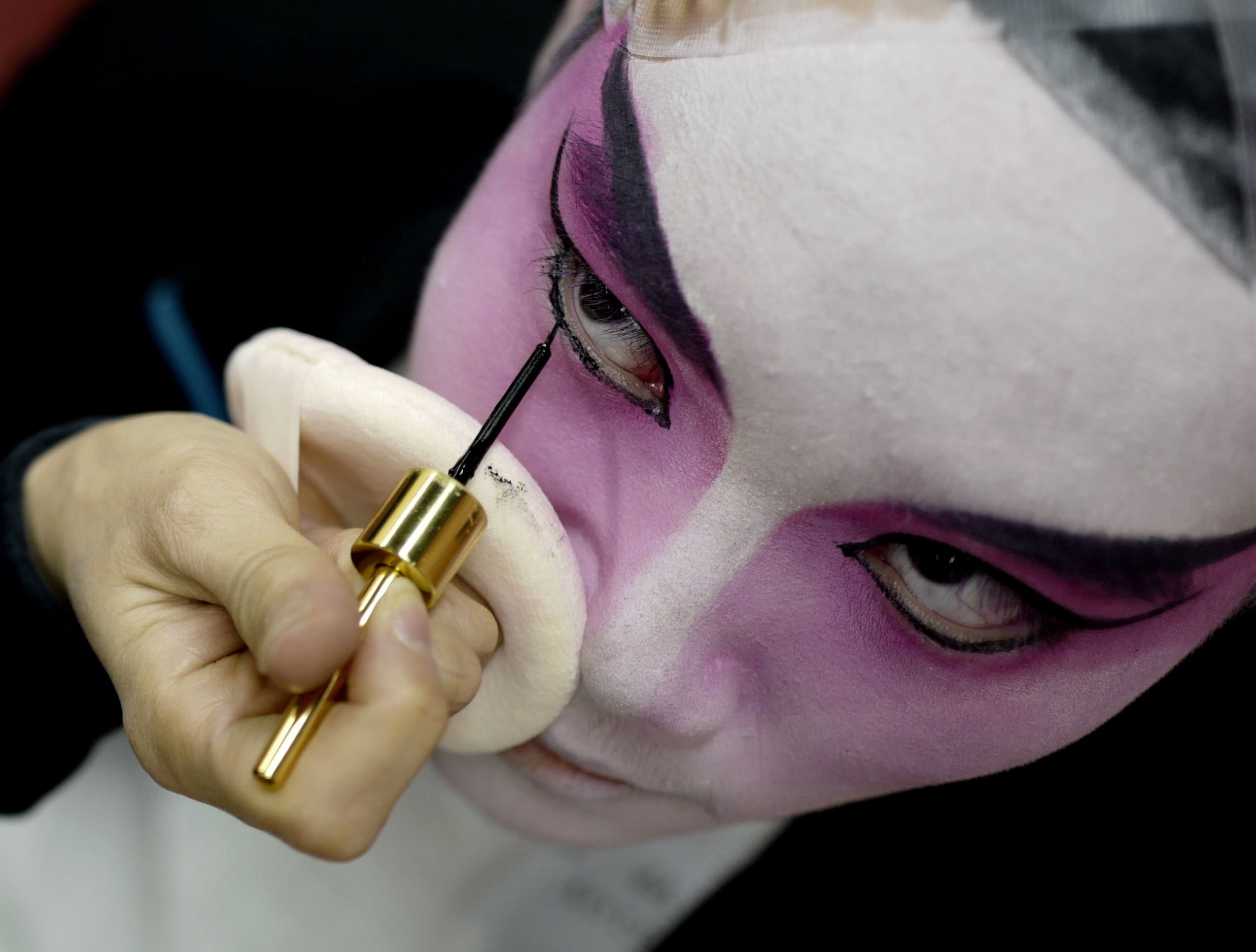 A young opera artist is applied a makeup before a performance during the Children's Cantonese Opera 2018 at Rosemead High School on Jan. 13, 2018.