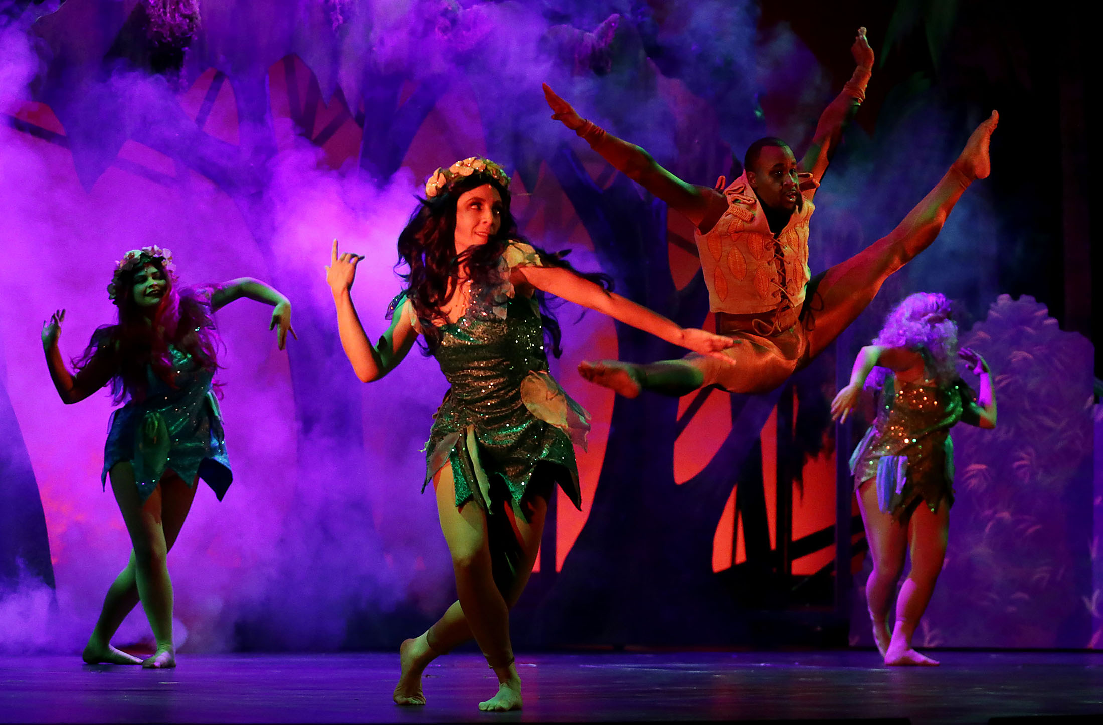 Members of the ensemble dance and sing during the Disney musical Tarzan dress rehearsal at Landis Performing Arts Center in Riverside on Wednesday, January 30, 2019.