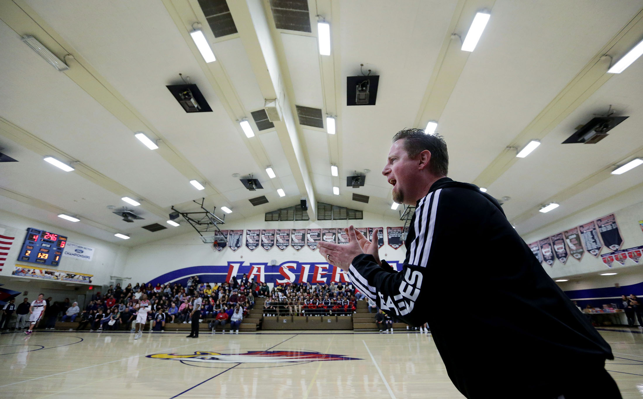 La Sierra boys basketball coach Justin Norman barks out orders to his team center court as he coach the Eagles against Patriot at La Sierra High School in Riverside on Friday, January 11, 2019.