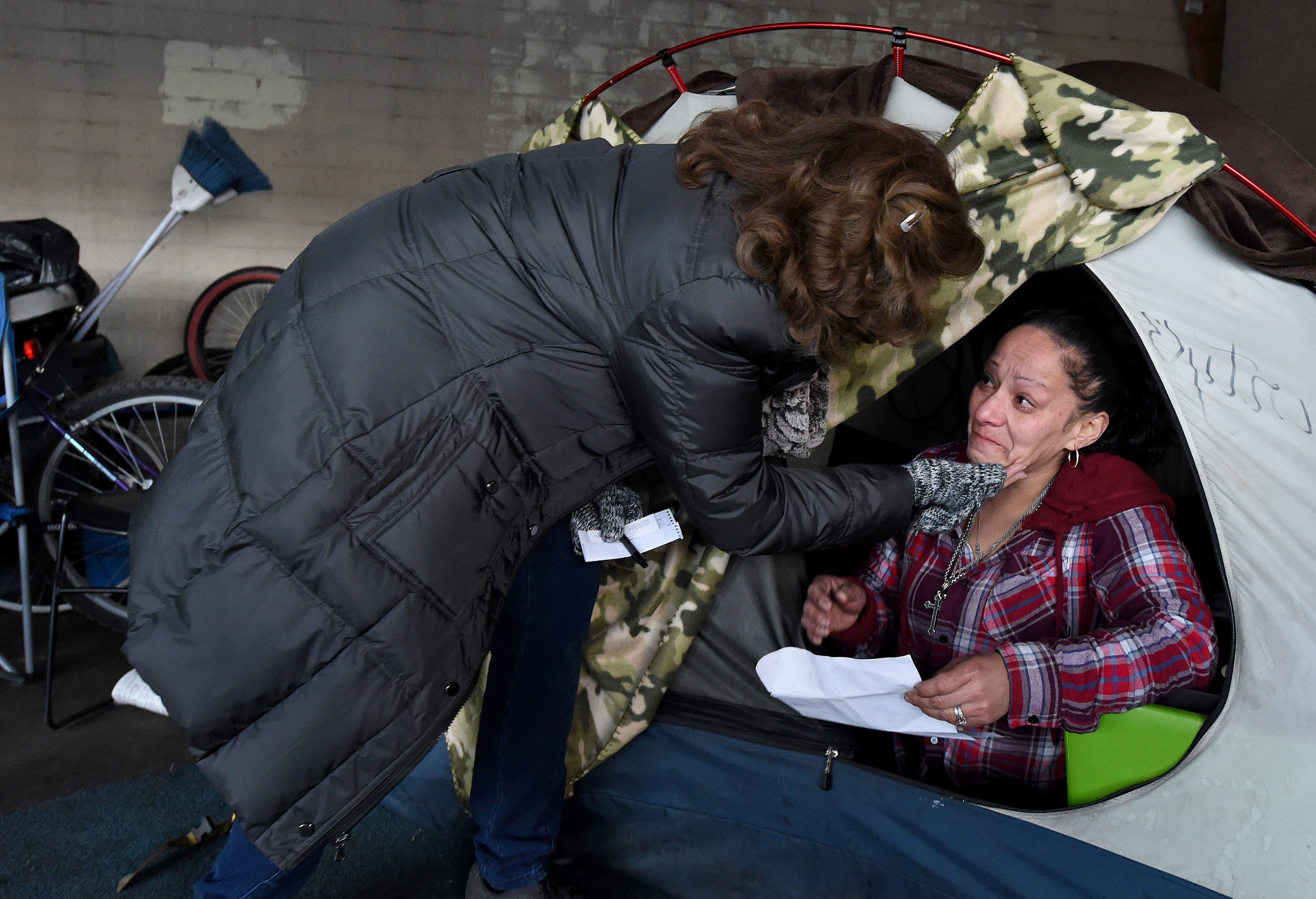 San Bernardino County 5th District Supervisor Josie Gonzales (left) gives a caring touch to Sylvia, 38 from Pasadena and homeless for the past 3 years, under a building during the San Bernardino County 2019 Point-in-Time Homeless Count in downtown San Bernardino Thursday morning, January 24, 2019. The Point-in-Time Homeless Count (PITC) is a one-day street-based and service-based count and subpopulation survey of sheltered and unsheltered individuals to identify how many people in San Bernardino County are homeless and their subpopulation characteristics on a given day. Information was also given out to help those who wished to improve their situation.