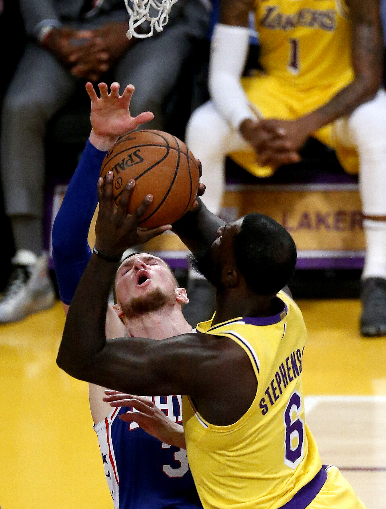Philadelphia 76ers' Mike Muscala (31) defends as  Los Angeles Lakers' Lance Stephenson (6) shoots during an NBA basketball game, Jan. 29, 2019, in Los Angeles.