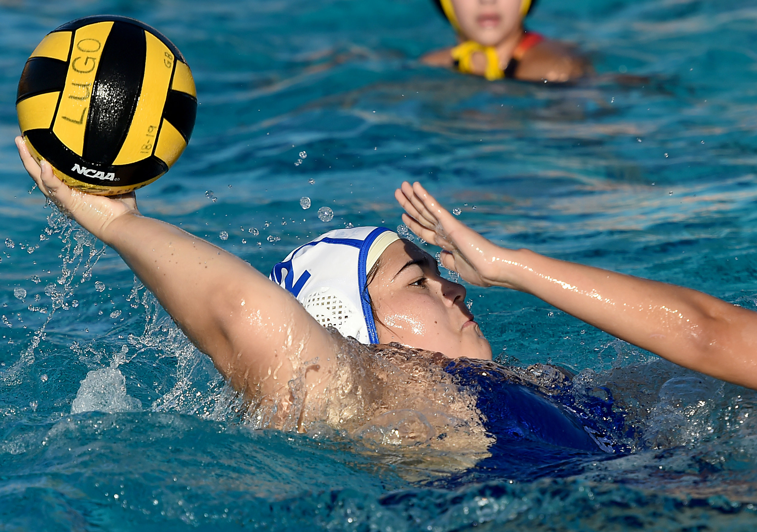 Chino's Lauren Alatorre tries to pass against Don Lugo defense during a girls varsity water polo match at Don Lugo High School in Chino on Thursday, January 24, 2019. Chino defeated Don Lugo 5-4.
