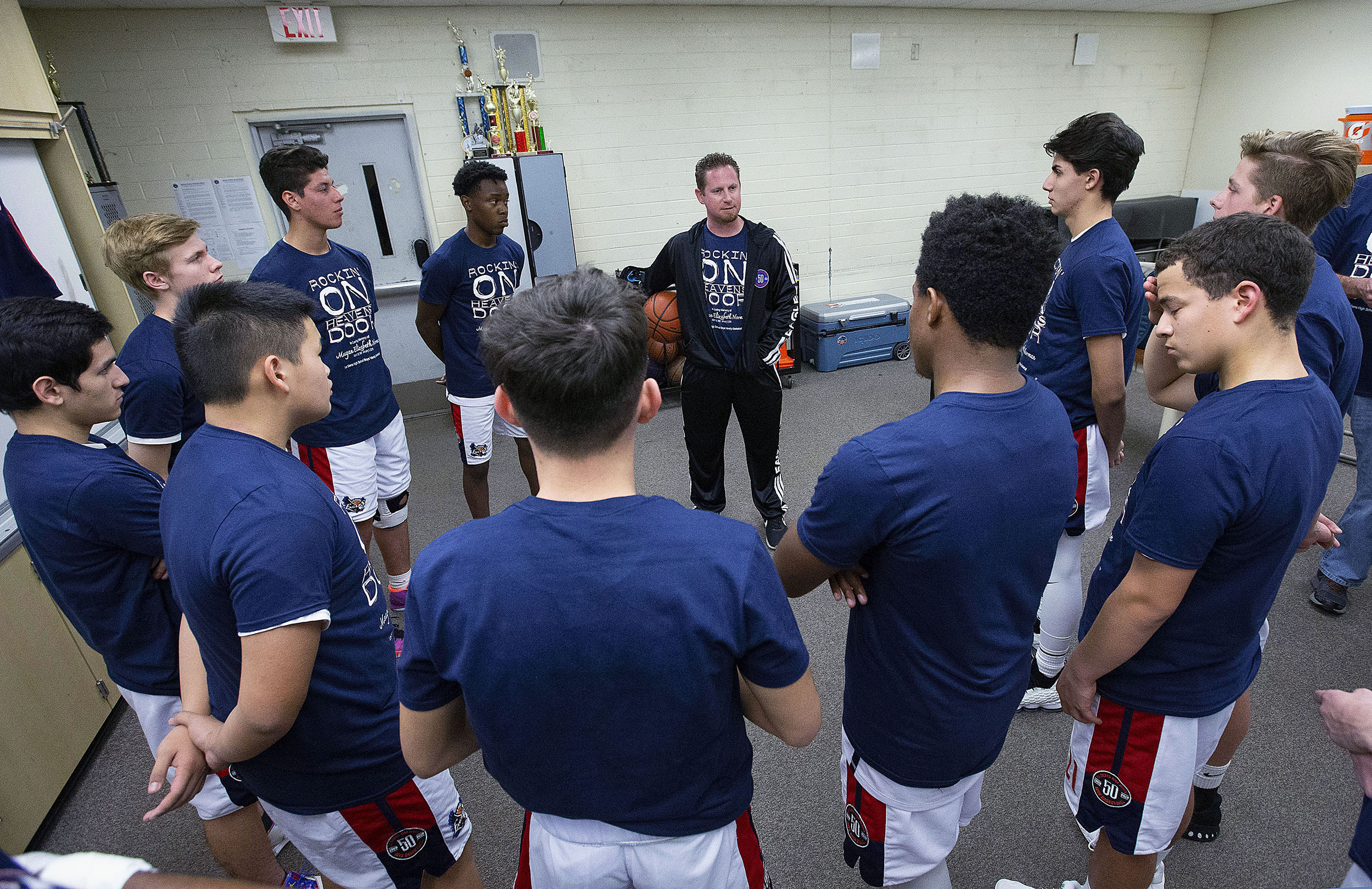 La Sierra basketball team look and listen to coach  Justin Norman gets them ready to play Patriot in the team room  in Riverside on Friday, January 11, 2019.