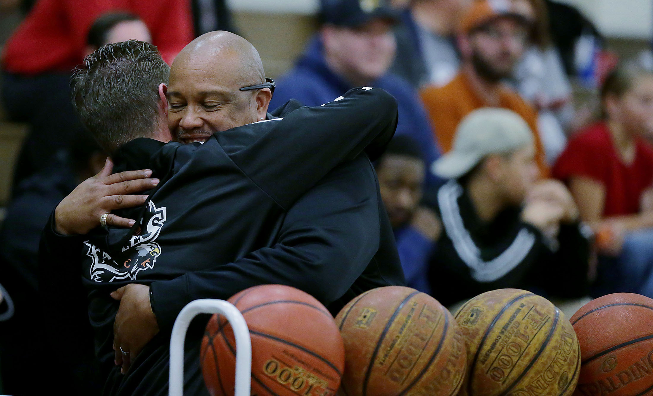La Sierra boys basketball coach Justin Norman got hugs all night long from fans and supporters after his wife, Meagan, who's sudden death 10 days ago shocked the La Sierra sporting family in Riverside on Friday, January 11, 2019.