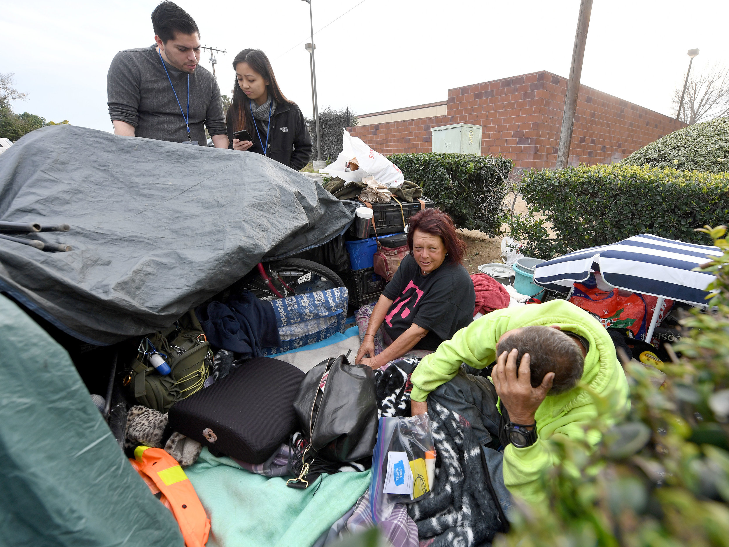 UCR medical students Josue Reynaga and Betty Nguyen, gather information from Annette Alonzo, 53, and William Robinett, 53, from their overnight camp in a parking lot near the intersection of Tyler and Hole streets during the 2019 Point-in-Time Homeless Count and Survey in Riverside Tuesday morning, January 29, 2019. Over 700 volunteers took part in the county wide count using a specially designed phone app to gather information from individuals.