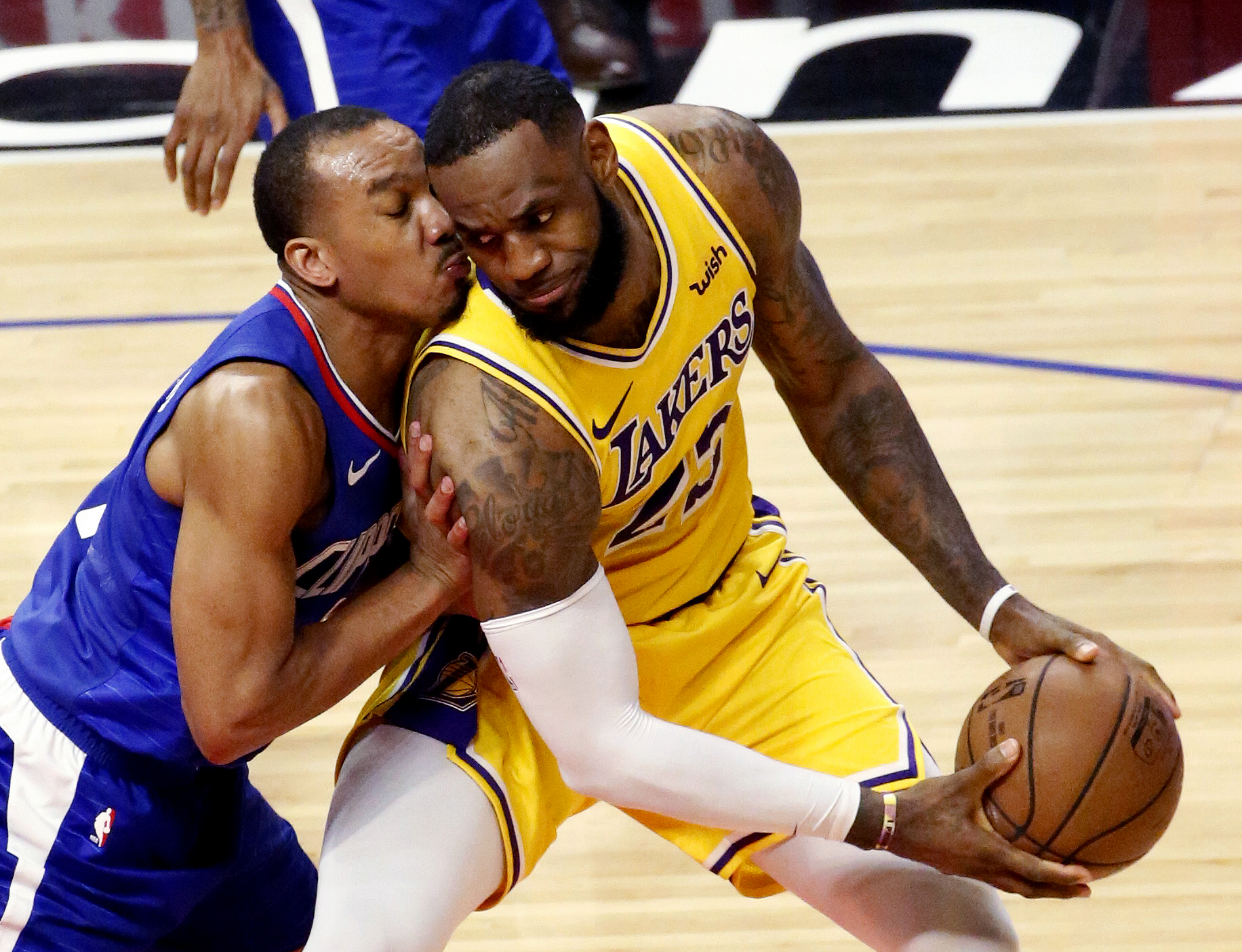 Los Angeles Clippers' Avery Bradley (11) defends on Los Angeles Lakers' LeBron James (23) during an NBA basketball game, Jan. 31, 2019, in Los Angeles.