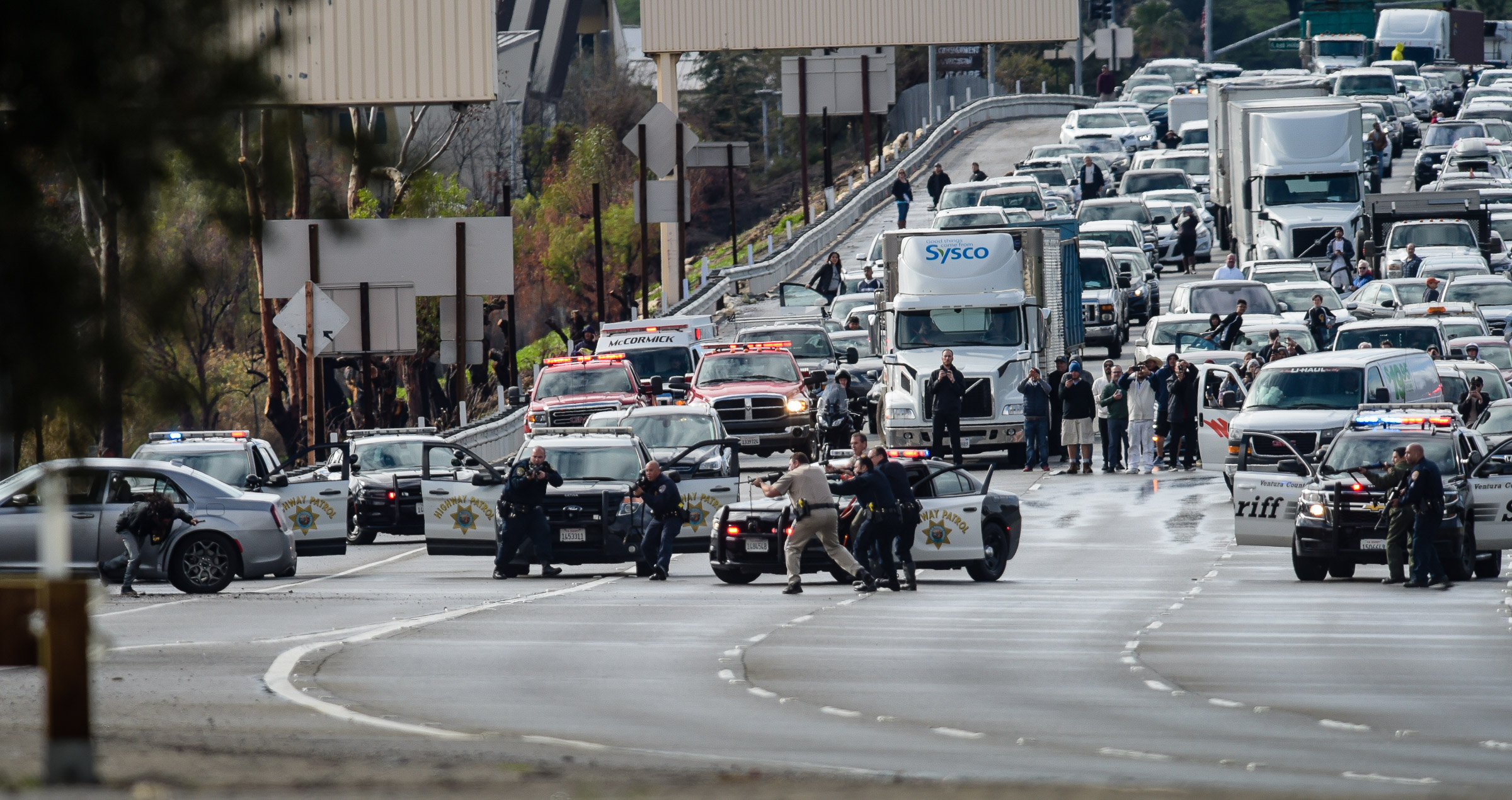 Dimas Diaz Jr., 43, of Santa Barbara is shot by law enforcement officers following a pursuit and standoff on Highway 101 at the Las Virgenes Road exit in Calabasas on Jan. 12, 2019.