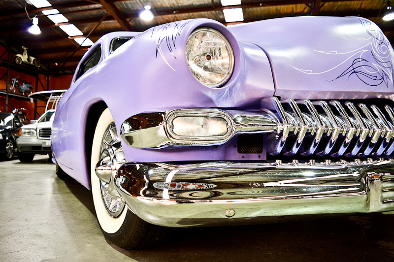 This 1949 Mercury Eight with a 350 Chevy Engine rolled in on to the Showroom floor late last week. Complete with white walls, original bench seats, chrome from head to toe and some wild pin striping work.